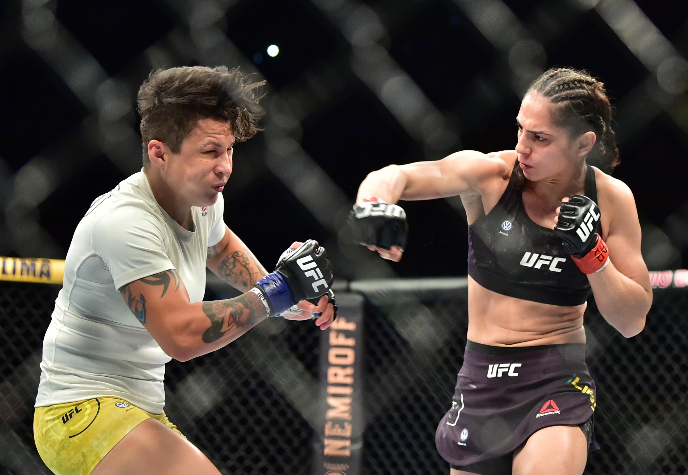 Ariane Lipski (red gloves) fights Isabela De Pauda (blue gloves) during UFC Fight Night at Ginsasio do Ibirapuera
