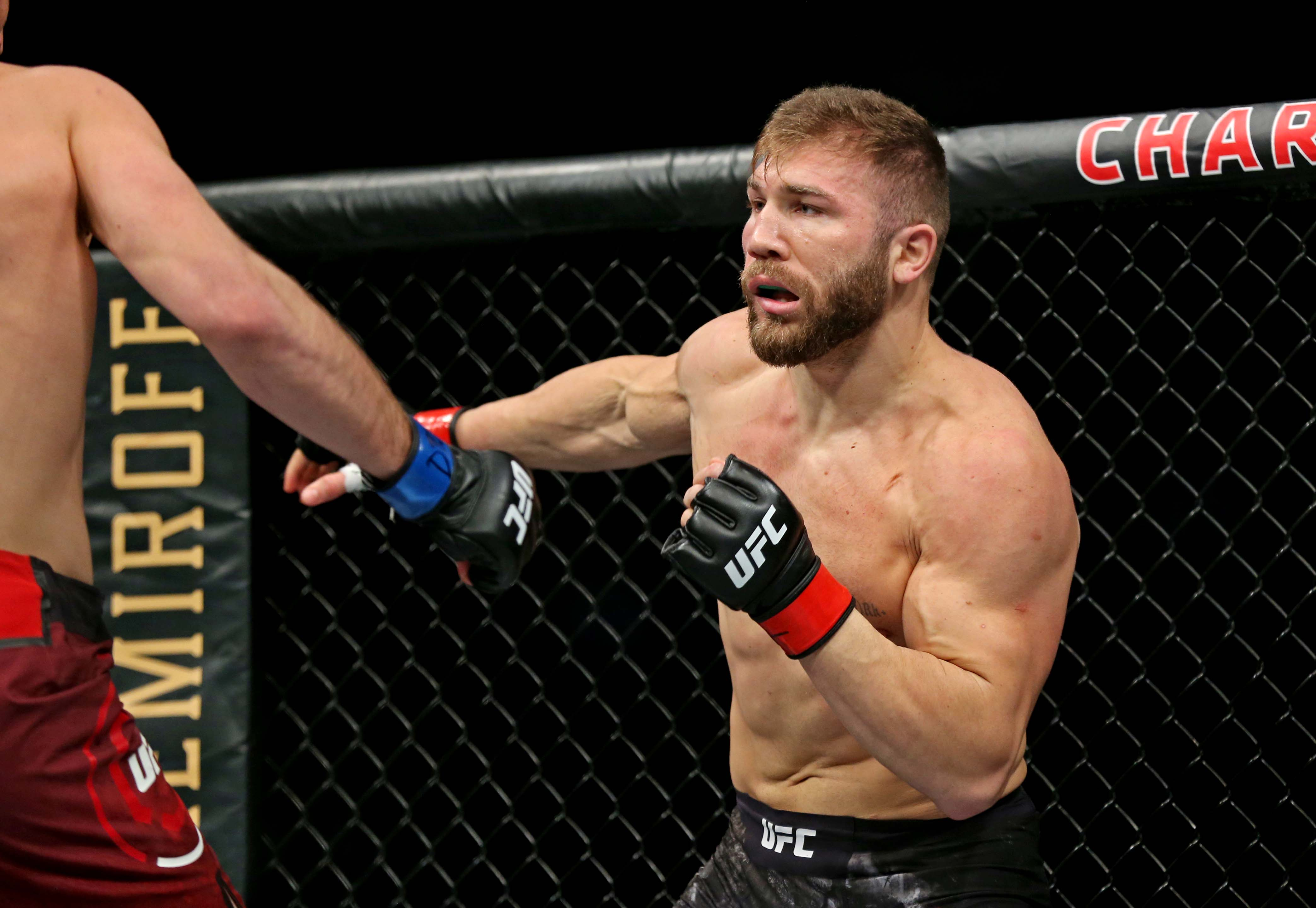 Ion Cutelaba (red gloves) fights Magomed Ankalaev (blue gloves) during UFC Fight Night at Chartway Arena