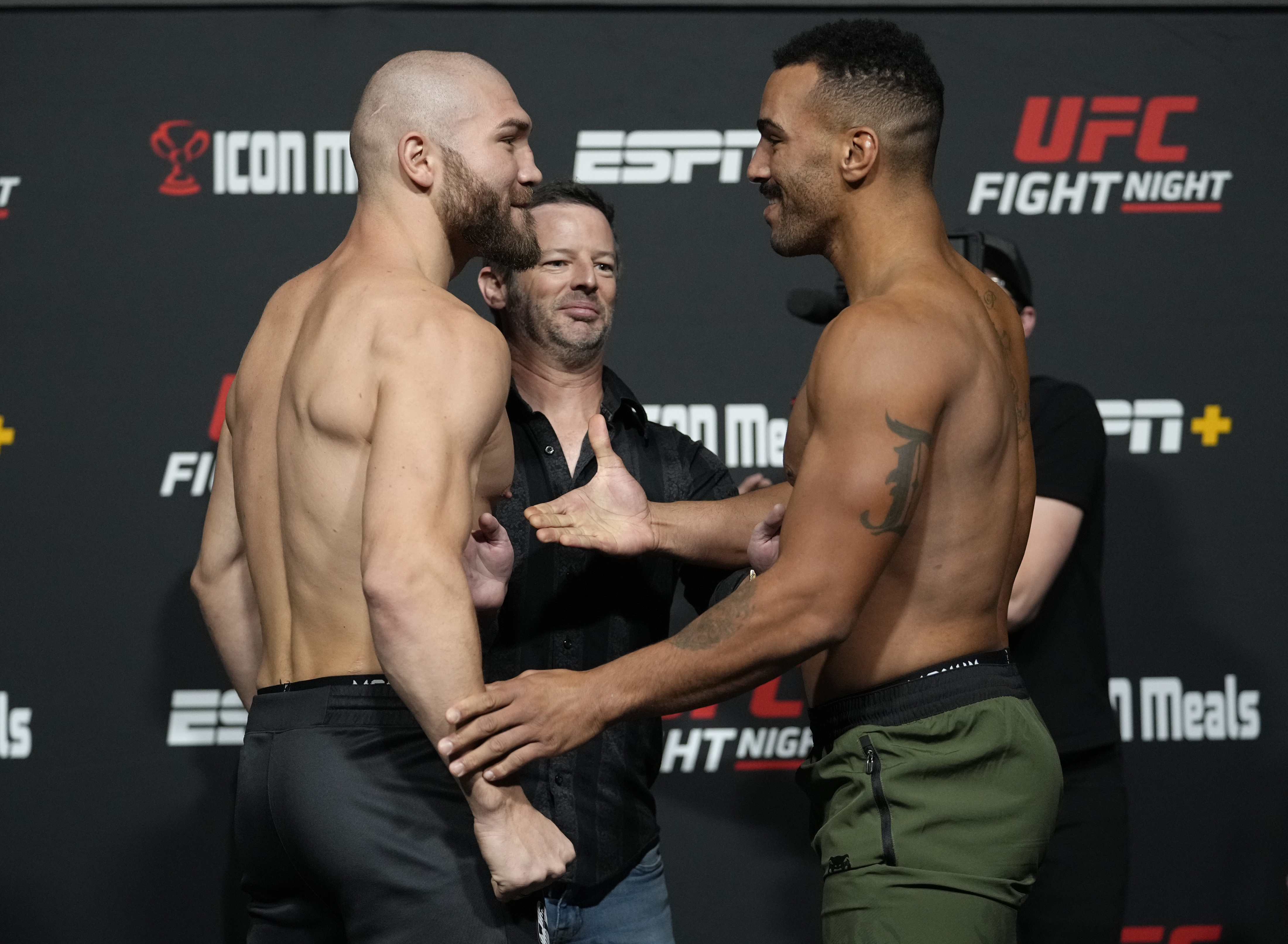 Opponents Ion Cutelaba of Moldova and Devin Clark face off during the UFC Fight Night weigh-in at UFC APEX on September 17, 2021 in Las Vegas, Nevada.