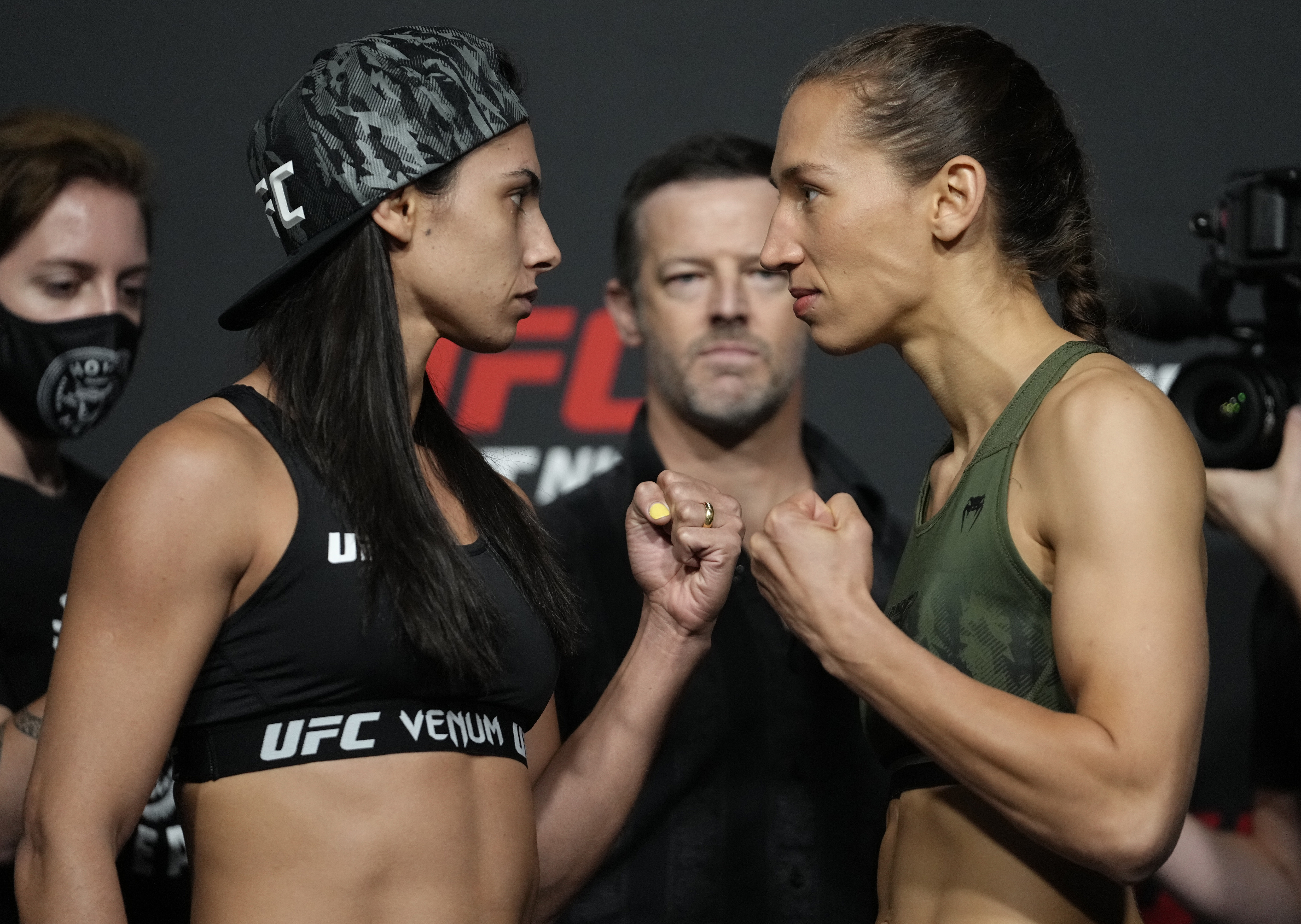 Opponents Ariane Lipski of Brazil and Mandy Bohm of Germany face off during the UFC Fight Night weigh-in at UFC APEX on September 17, 2021 in Las Vegas, Nevada.