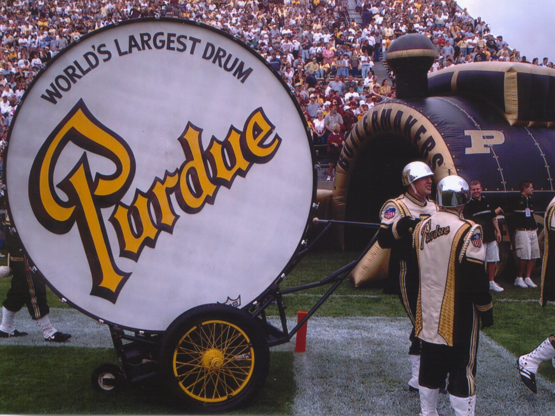 Band members of the Purdue University Boilermakers bring out the big drum at Ross-Ade Stadium in West Lafayette, Indiana.
