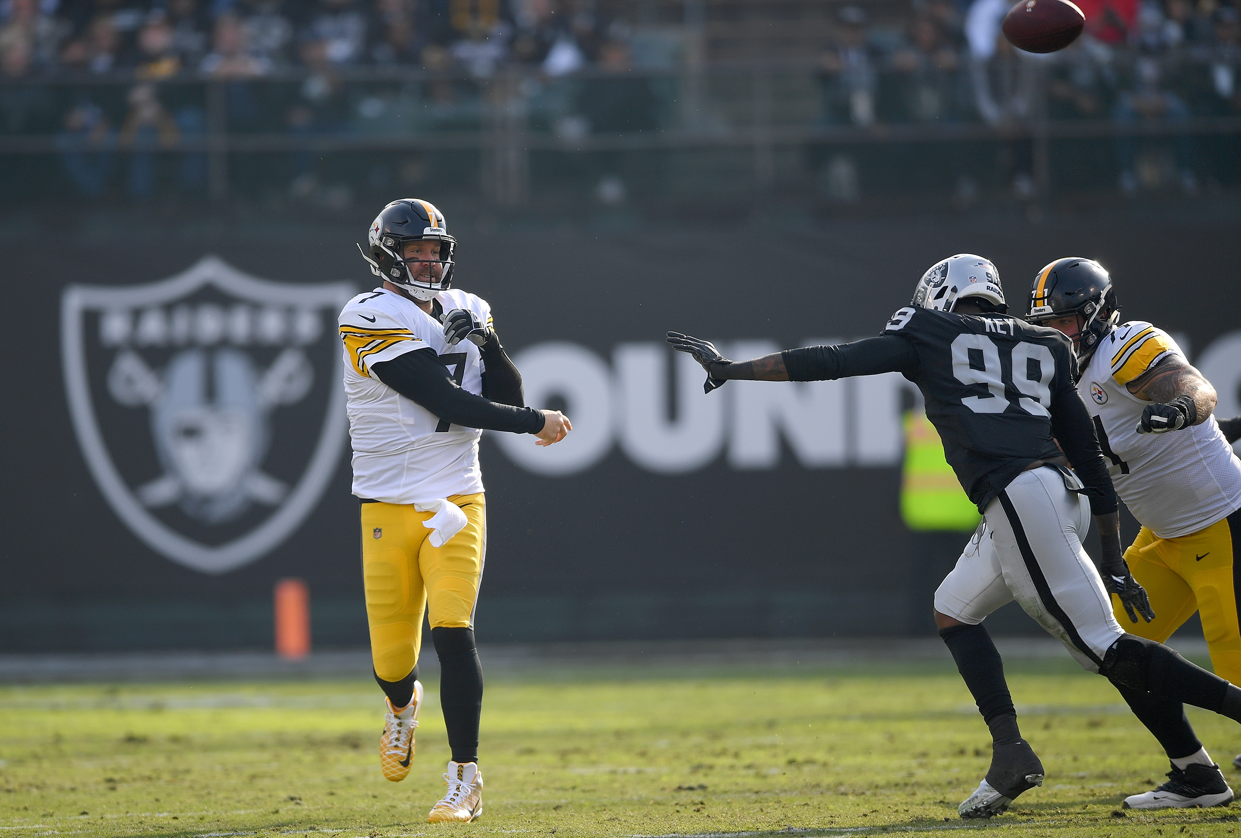 Ben Roethlisberger #7 of the Pittsburgh Steelers throws a pass against the Oakland Raiders during the first half of their NFL football game at Oakland-Alameda County Coliseum on December 9, 2018 in Oakland, California.