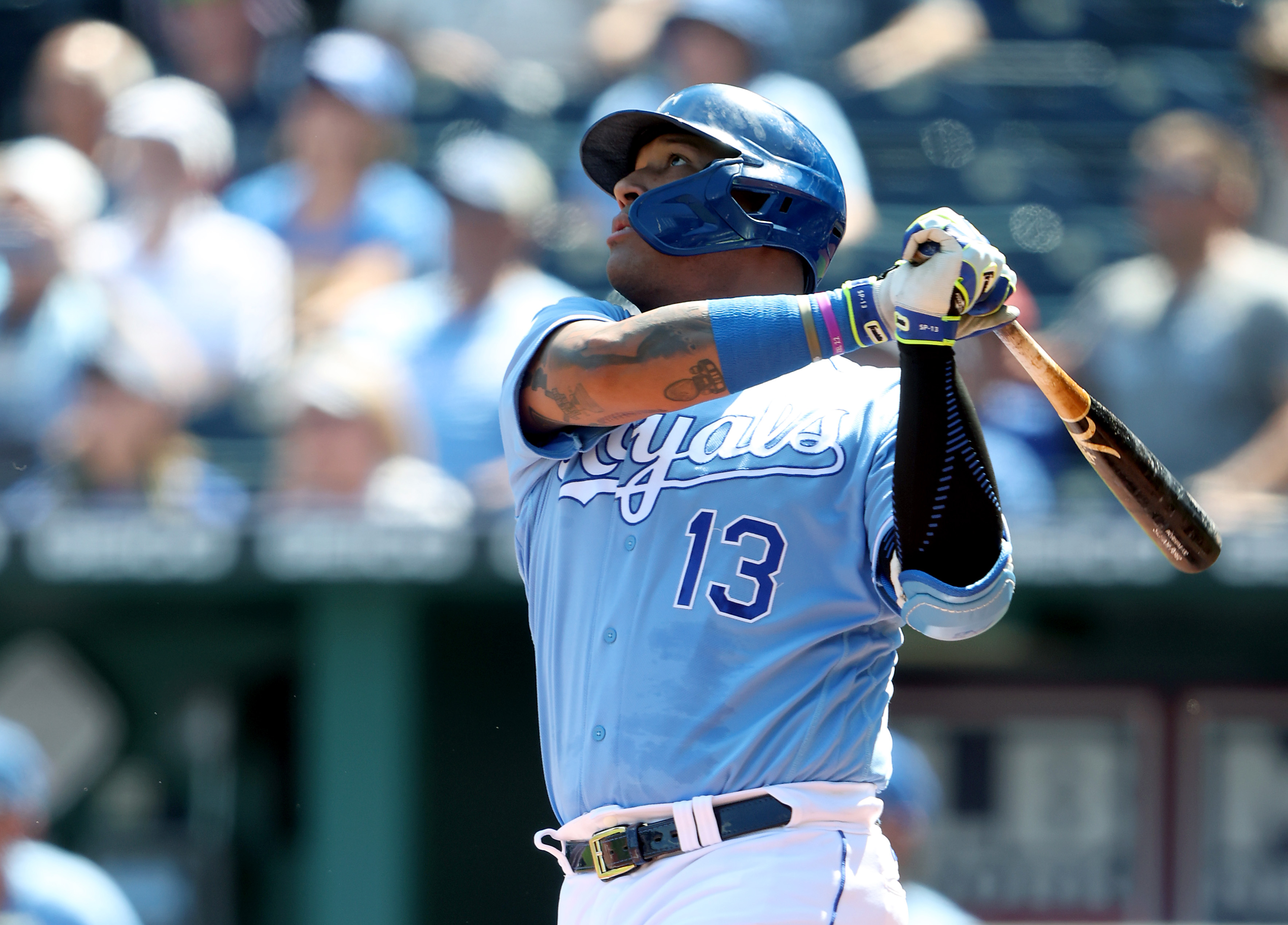 Salvador Perez watches a home run leave the park