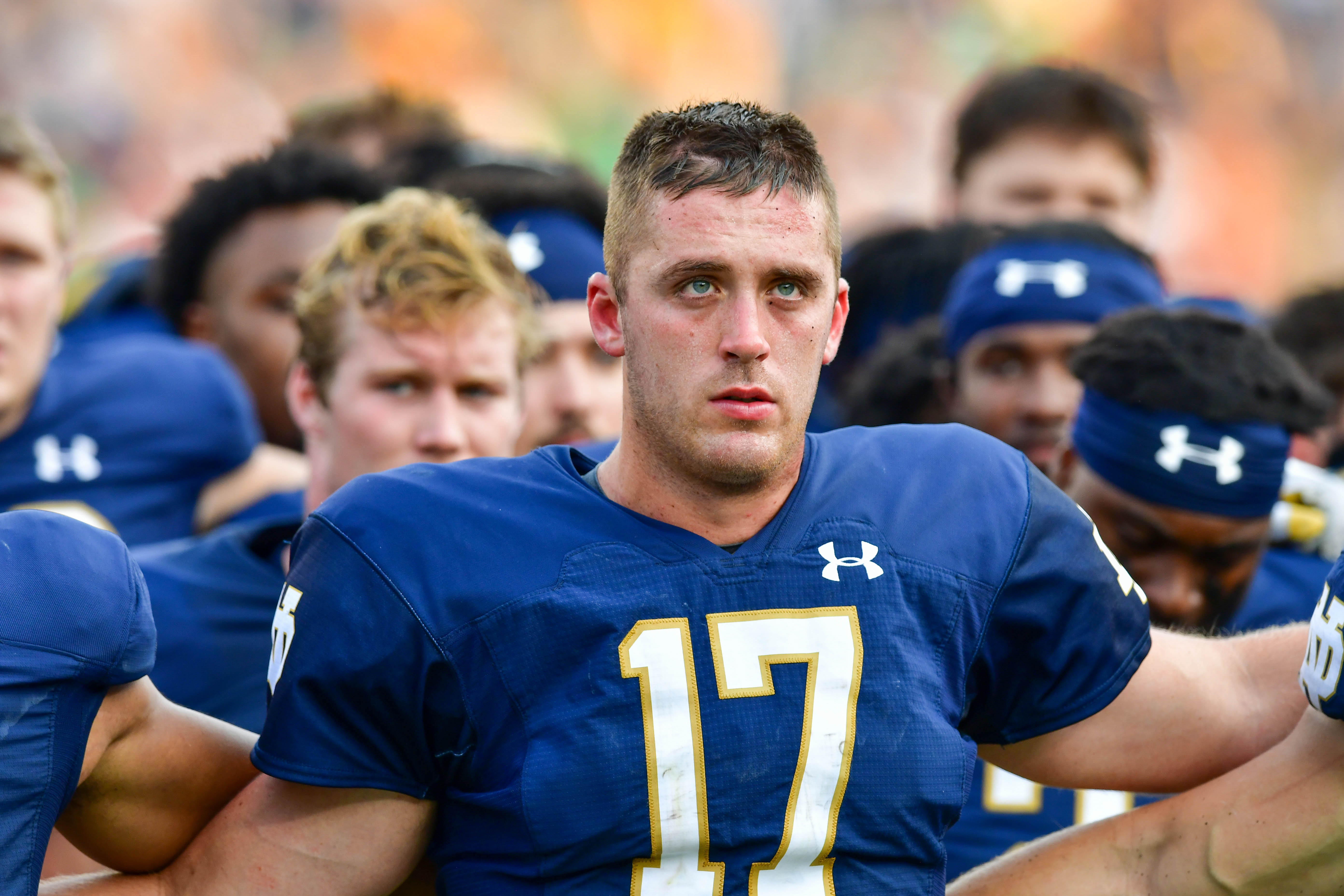 Notre Dame Fighting Irish quarterback Jack Coan joins his teammates for the Notre Dame Alma Mater after the game against the Toledo Rockets at Notre Dame Stadium.