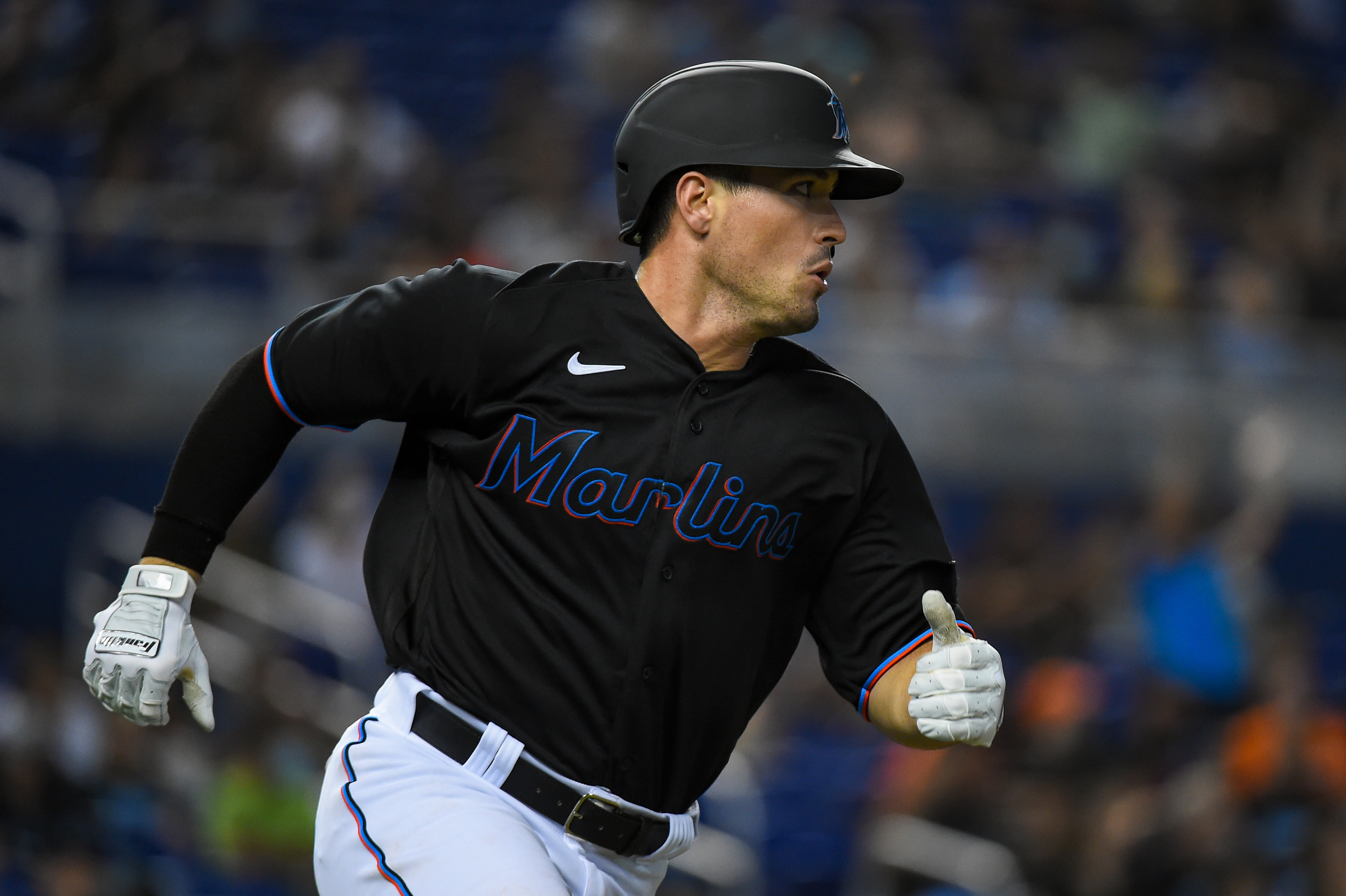 Nick Fortes #84 of the Miami Marlins runs towards first base after hitting a single in the first inning against the Pittsburgh Pirates at loanDepot park