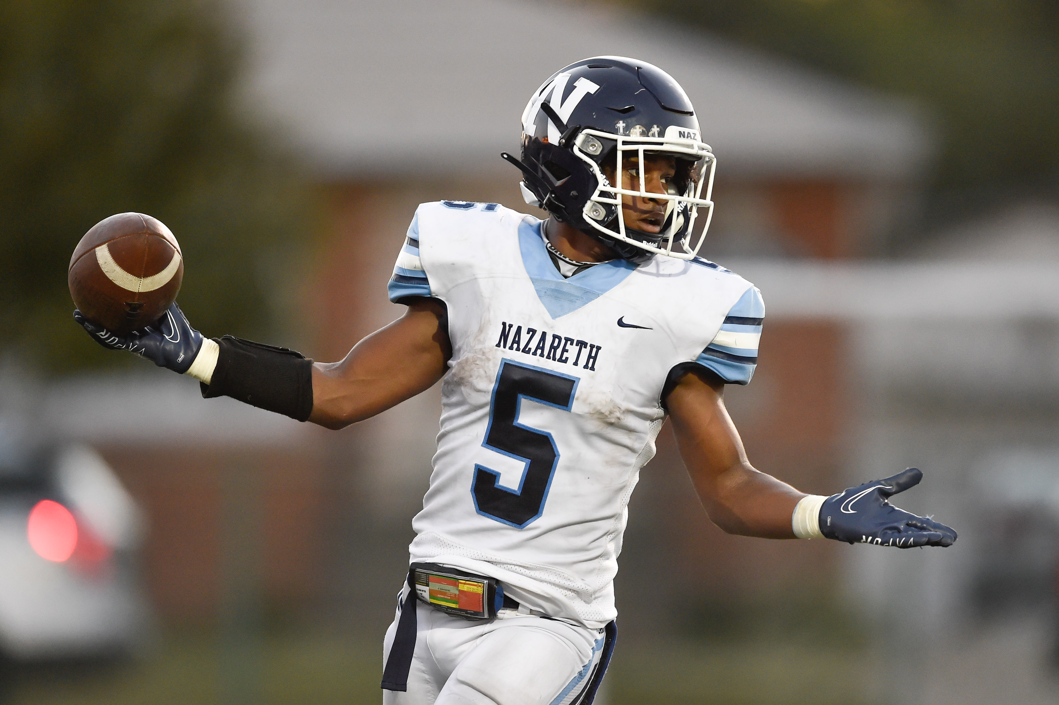 Nazareth's Kaleb Miller (5) reacts after scoring a touchdown against Notre Dame.