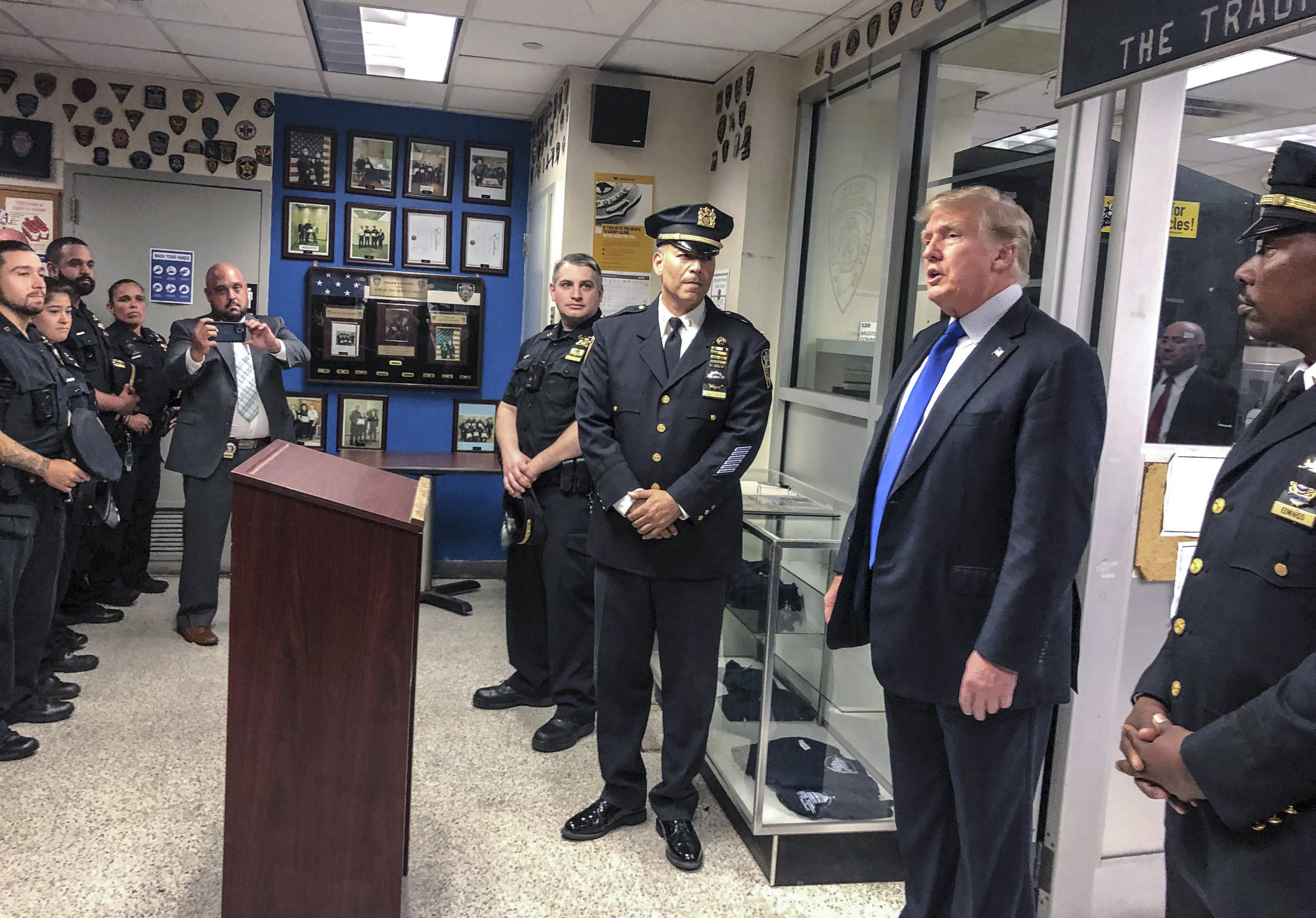 Former President Donald Trump visits the New York Police Department's 17th police precinct on Saturday, Sept. 11, 2021.