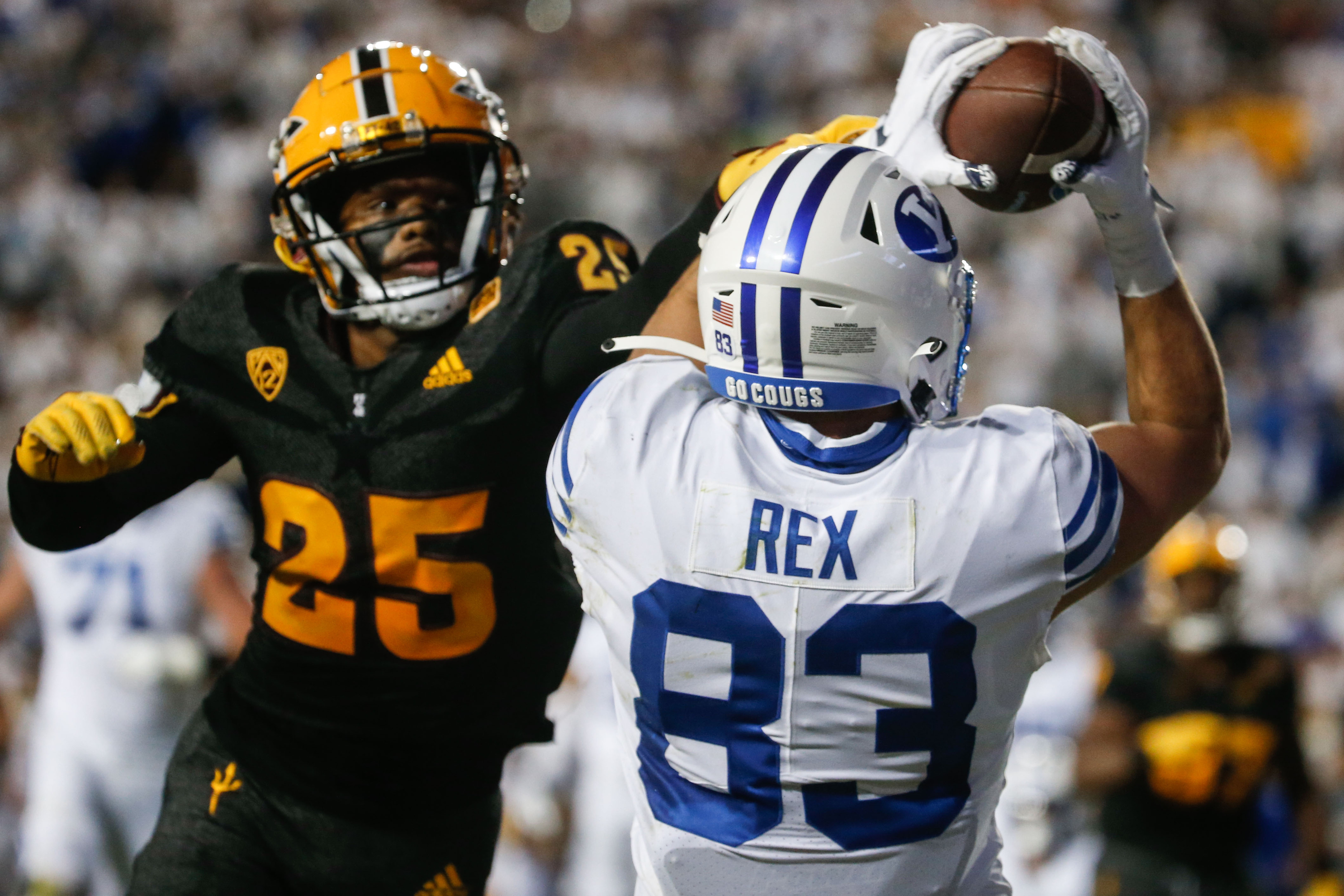 Brigham Young tight end Isaac Rex (83) receives the ball for a touchdown as Arizona State defensive back Macen Williams (25) tries to defend during an NCAA college football game at LaVell Edwards Stadium in Provo on Saturday, Sept. 18, 2021.