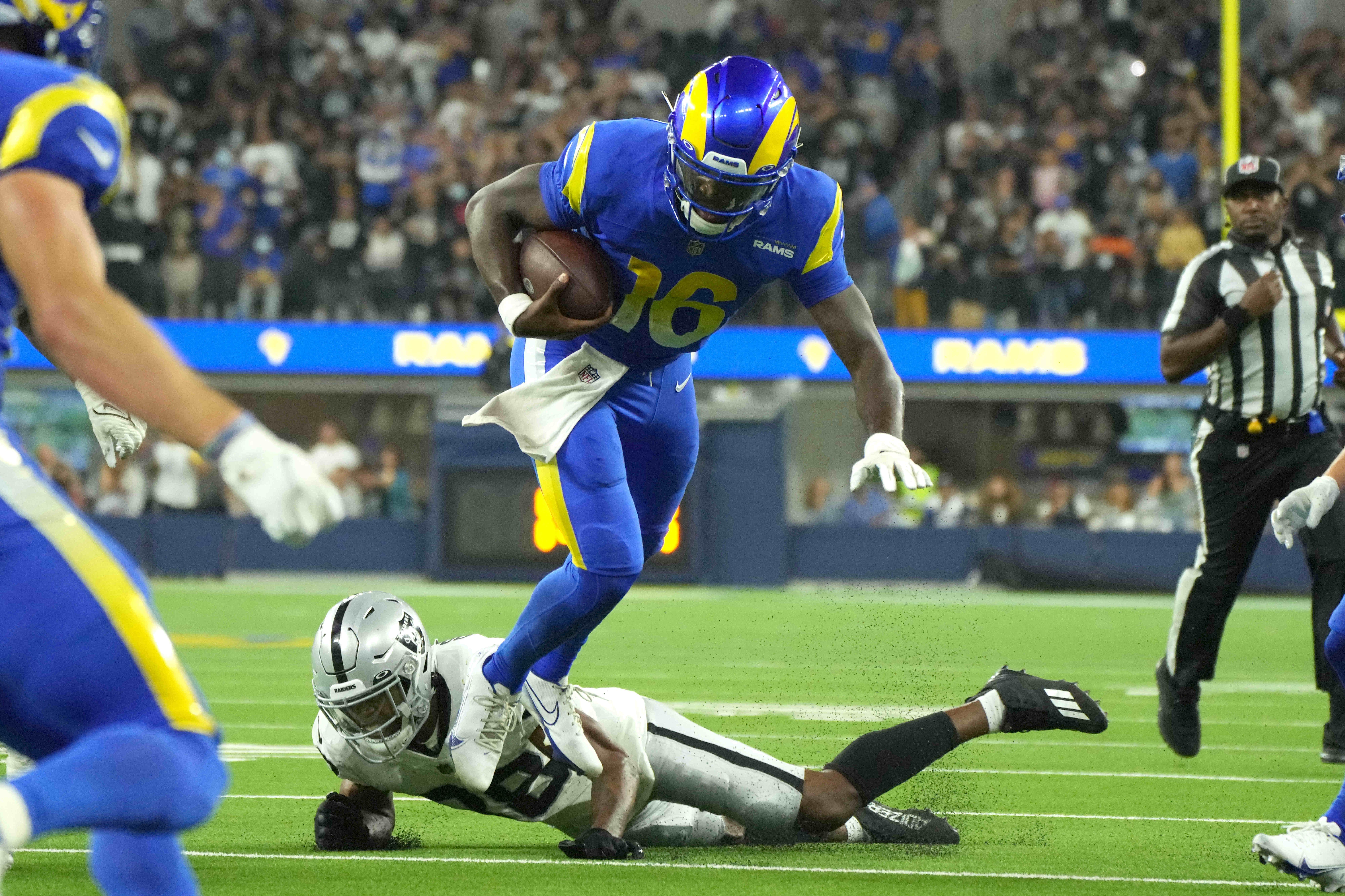 Los Angeles Rams quarterback Bryce Perkins (16) runs the ball against Las Vegas Raiders cornerback Rasul Douglas (38) in the fourth quarter at SoFi Stadium