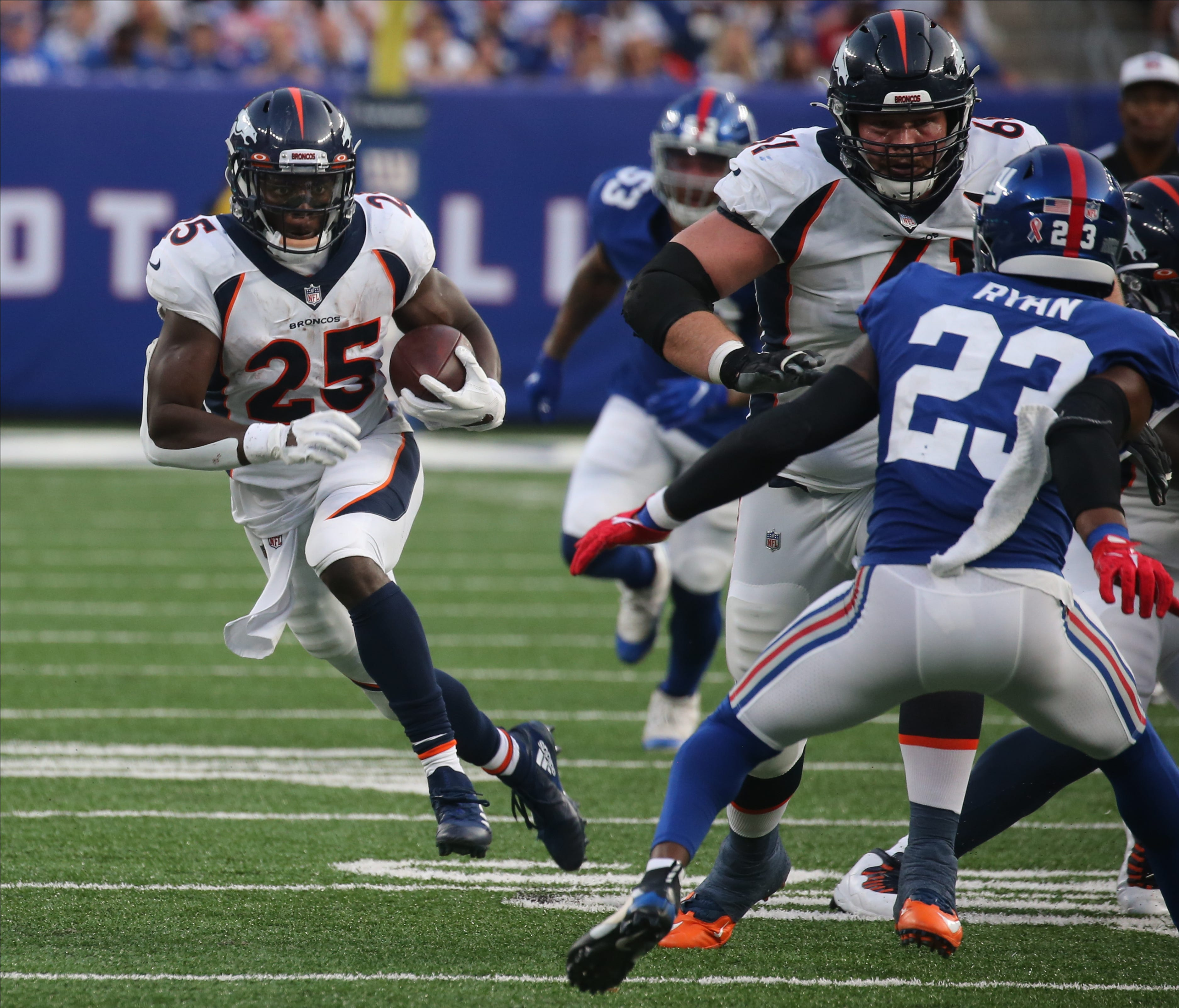 Melvin Gordon of Denver runs the ball in the fourth quarter as the Denver Broncos came to MetLife Stadium in East Rutherford, NJ and beat the New York Giants 27-13