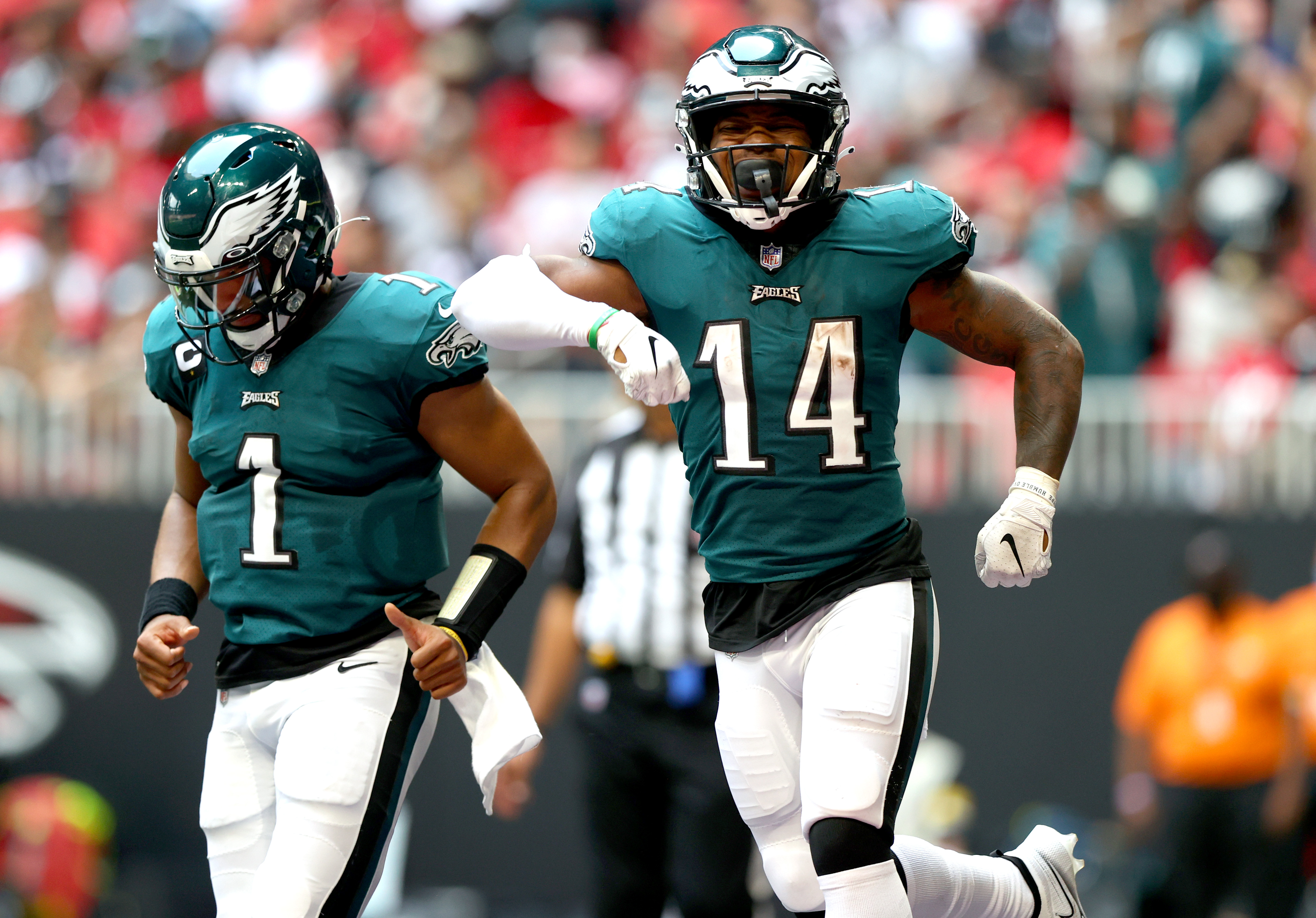 Kenneth Gainwell #14 and Jalen Hurts #1 of the Philadelphia Eagles celebrate after a touchdown during the fourth quarter at Mercedes-Benz Stadium on September 12, 2021 in Atlanta, Georgia.