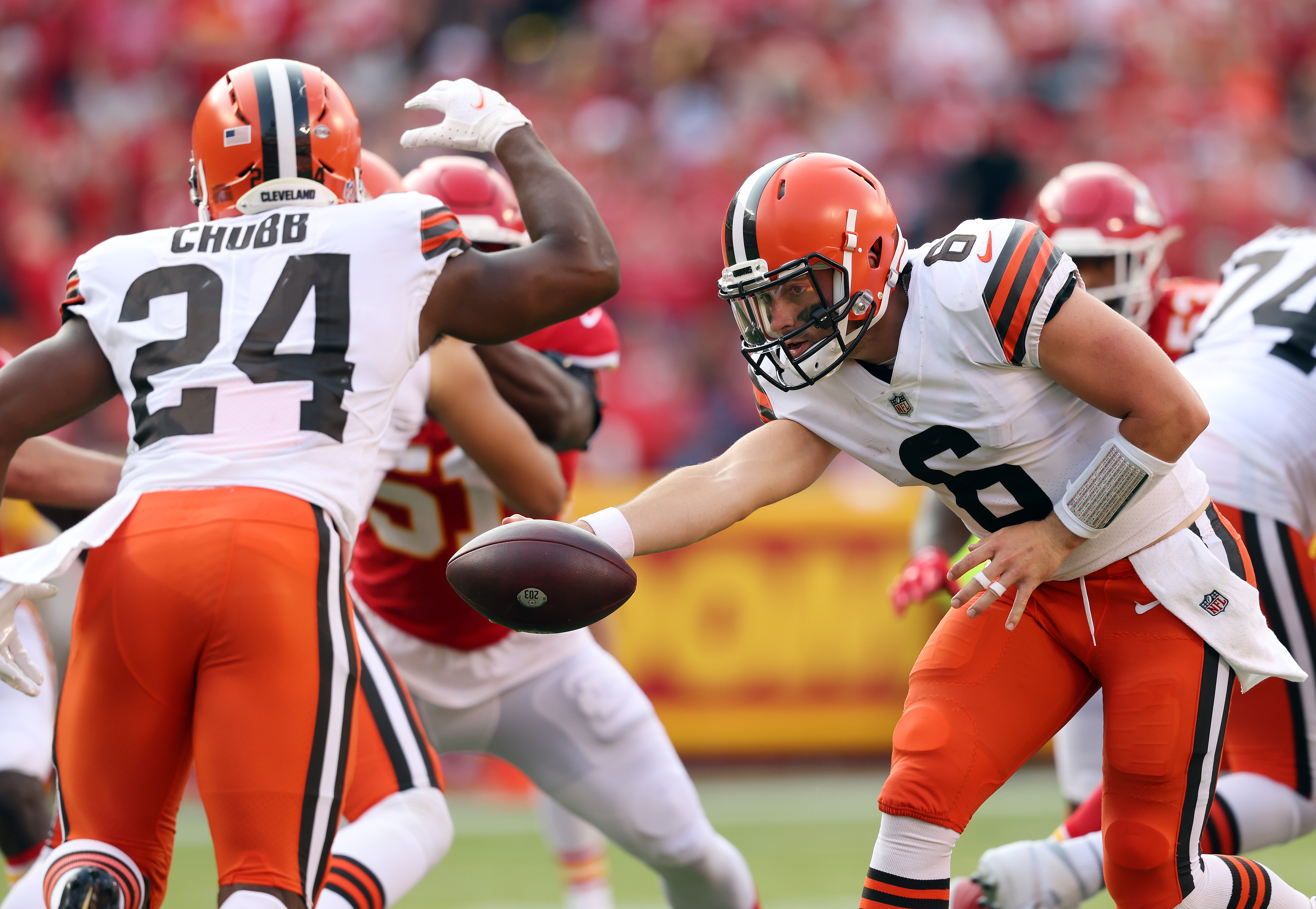 Quarterback Baker Mayfield #6 of the Cleveland Browns hands off to running back Nick Chubb #24 during the game against the Kansas City Chiefs at Arrowhead Stadium on September 12, 2021 in Kansas City, Missouri.