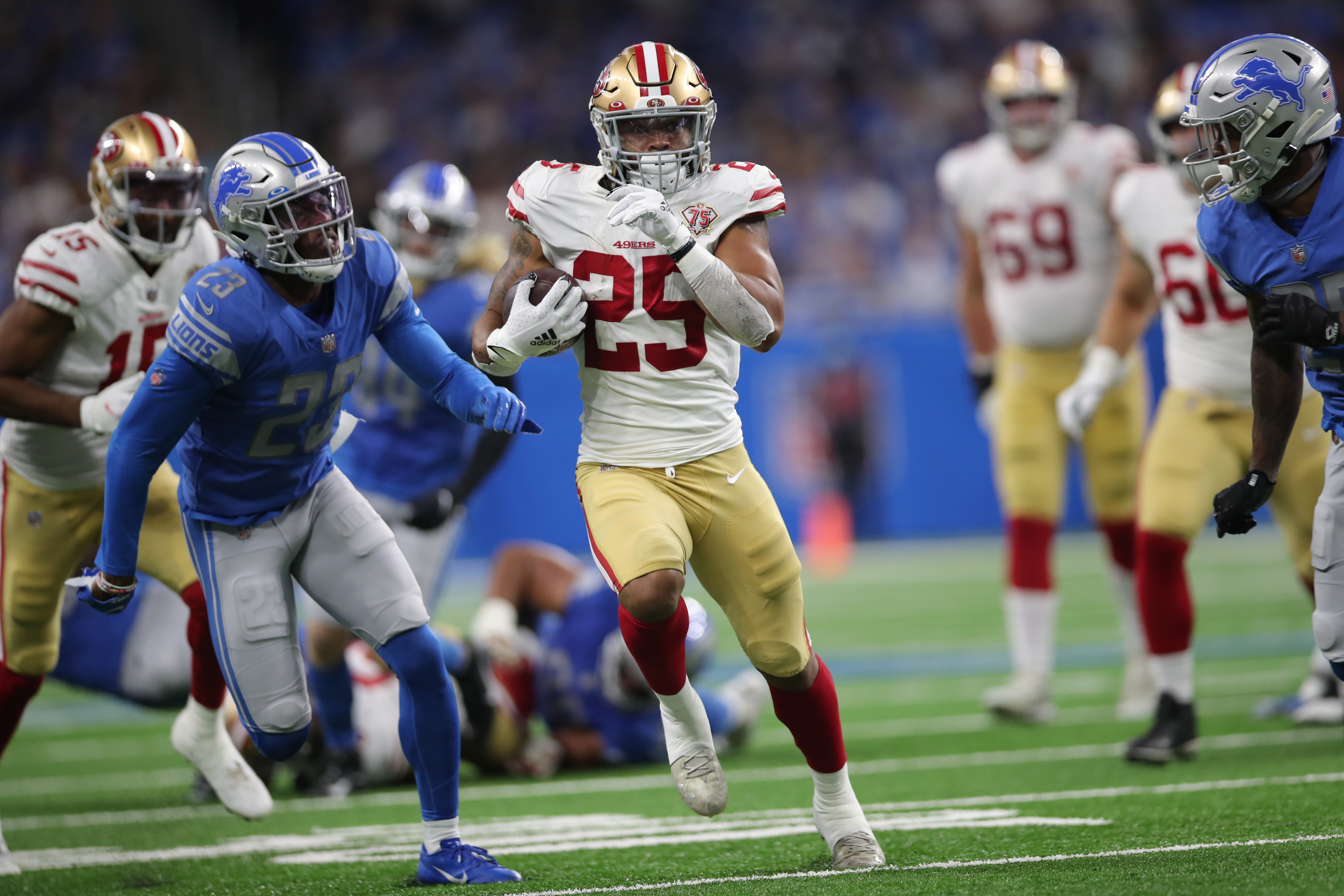 Elijah Mitchell #25 of the San Francisco 49ers rushes for a 38-yard touchdown during the game against the Detroit Lions at Ford Field on September 12, 2021 in Detroit, Michigan. The 49ers defeated the Lions 41-33.
