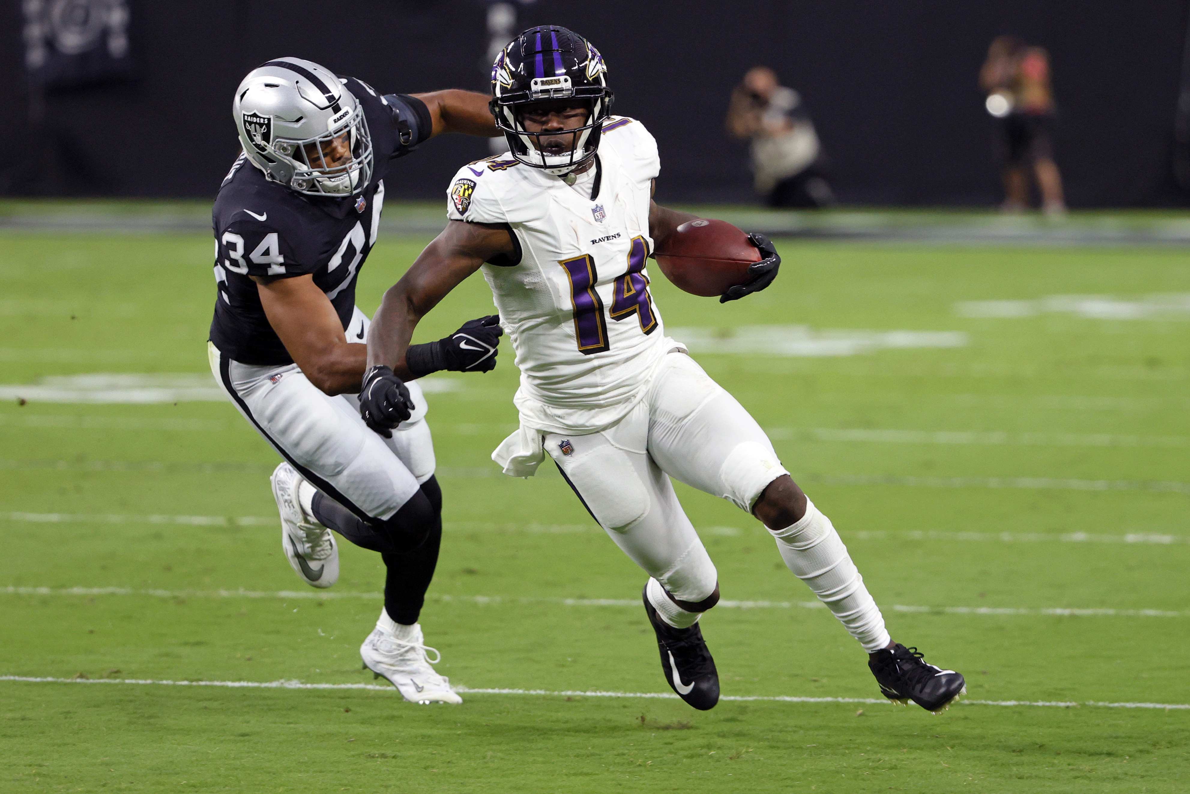 Sammy Watkins of the Baltimore Ravens runs for yardage after catching a pass against past K.J. Wright of the Las Vegas Raiders at Allegiant Stadium on September 13, 2021 in Las Vegas, Nevada.