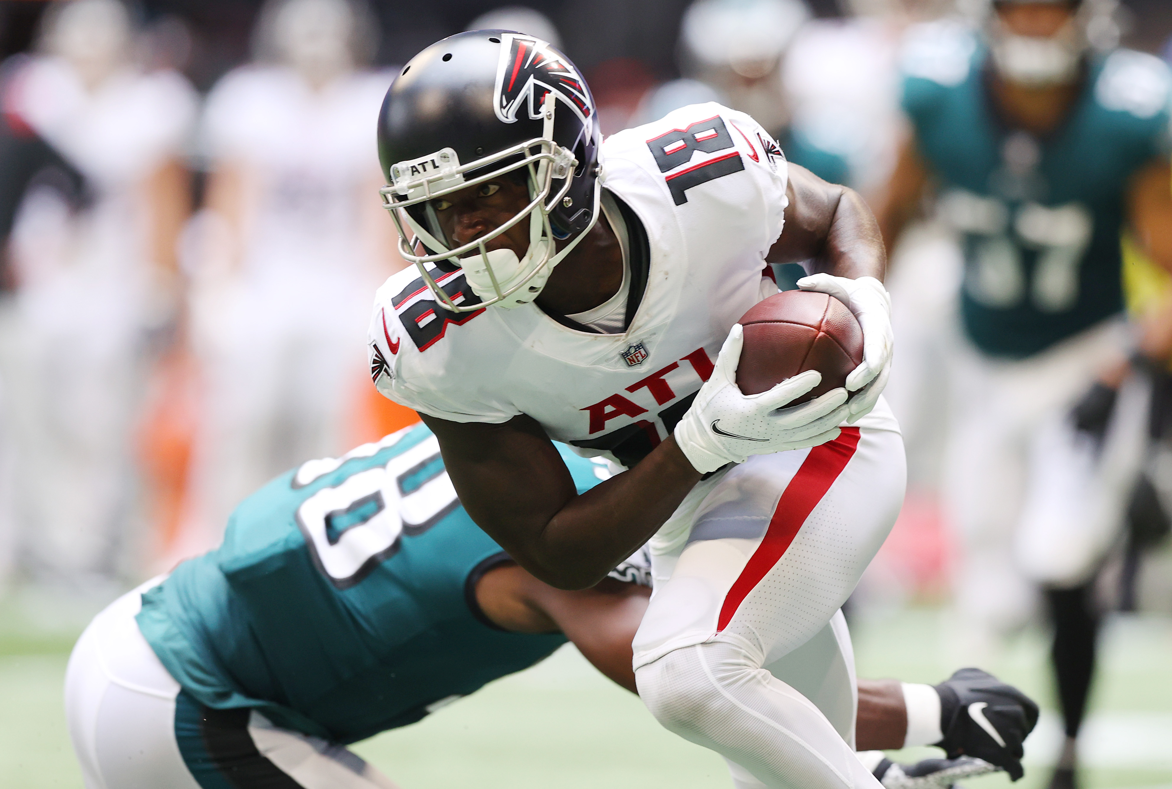 Calvin Ridley #18 of the Atlanta Falcons carries the ball against the Philadelphia Eagles during the third quarter at Mercedes-Benz Stadium on September 12, 2021 in Atlanta, Georgia.