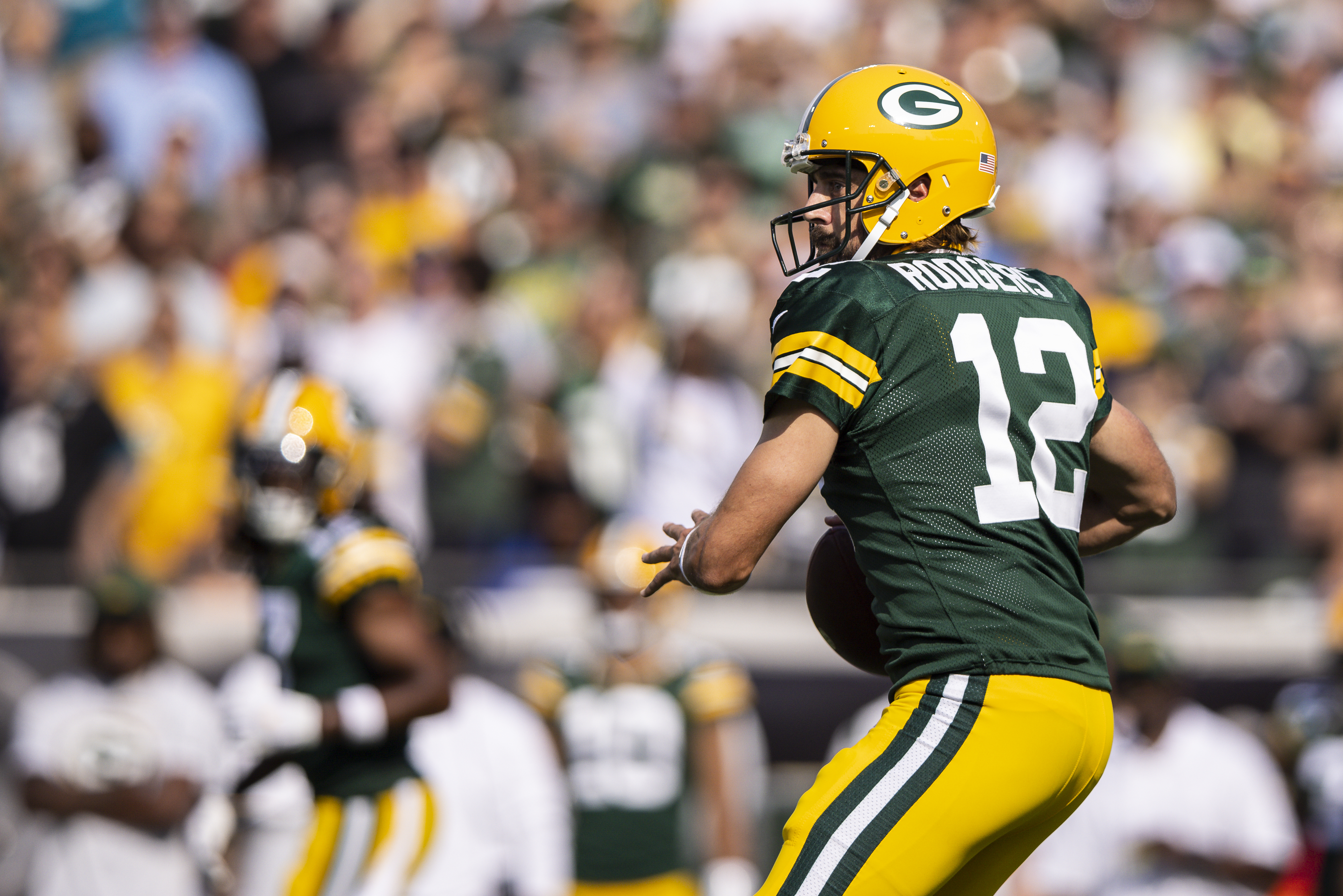 Aaron Rodgers #12 of the Green Bay Packers looks to pass during the first quarter of a game against the New Orleans Saints at TIAA Bank Field on September 12, 2021 in Jacksonville, Florida.