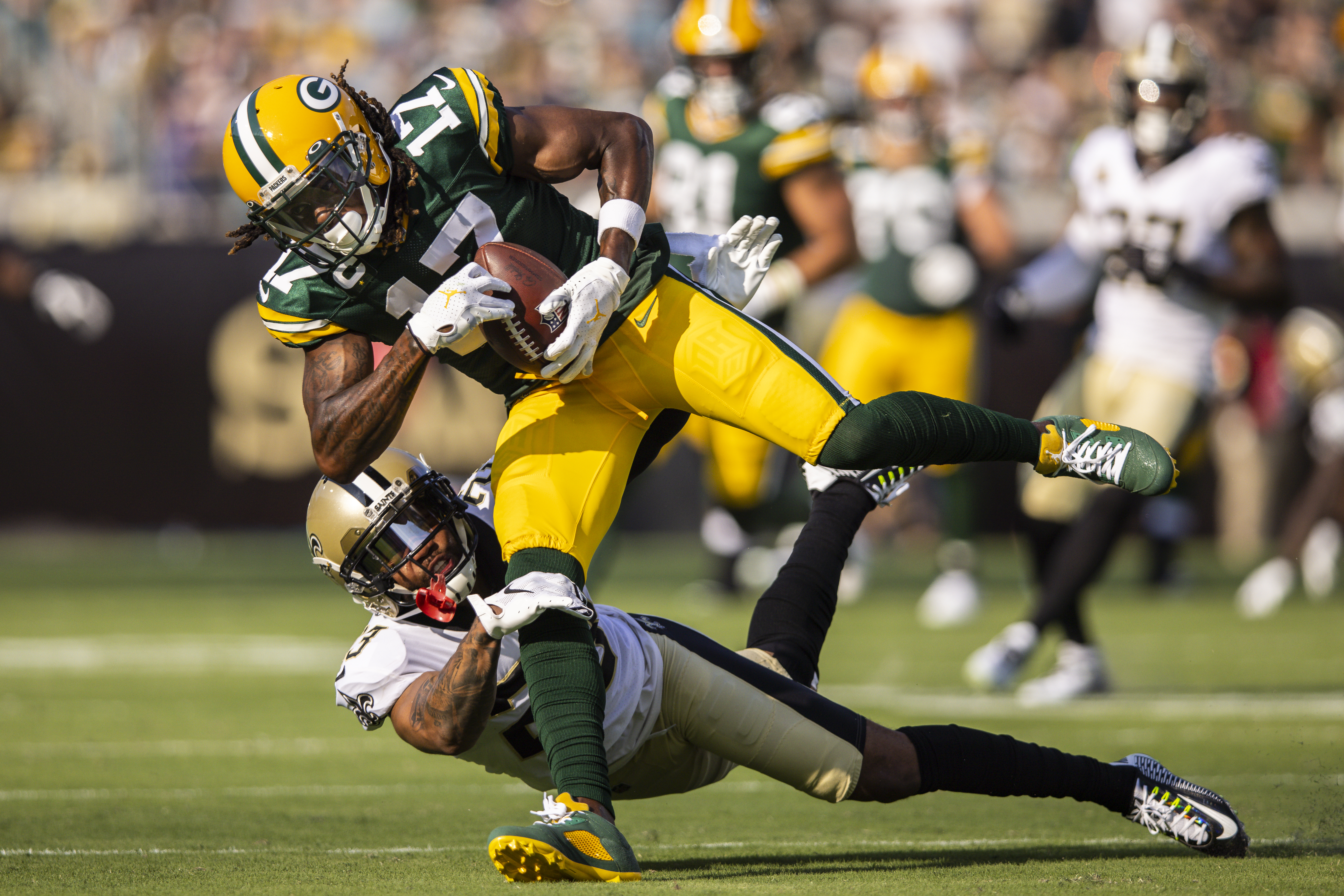 Davante Adams #17 of the Green Bay Packers makes a catch against Marshon Lattimore #23 of the New Orleans Saints during the first half of a game at TIAA Bank Field on September 12, 2021 in Jacksonville, Florida.