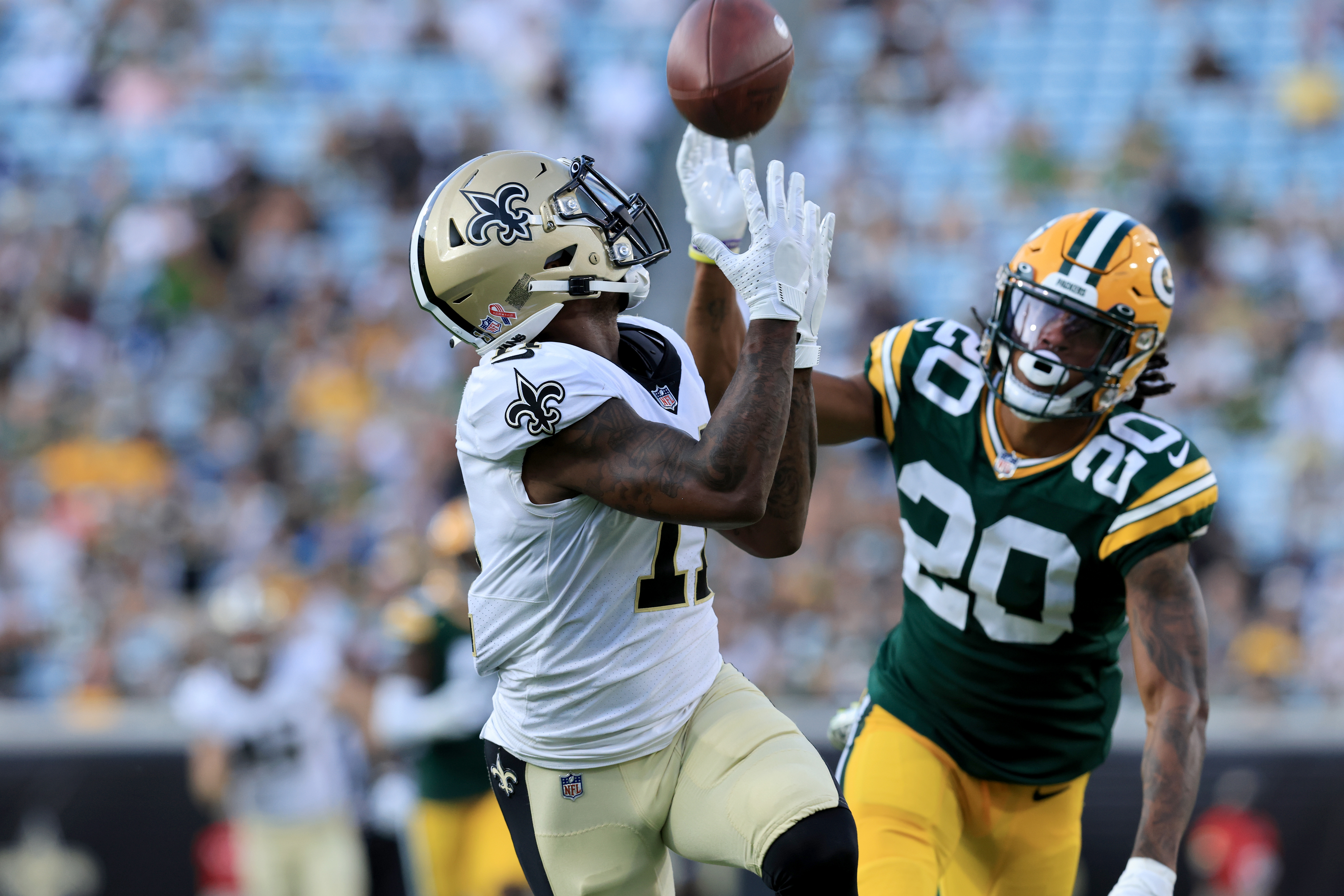 Deonte Harris #11 of the New Orleans Saints makes a reception for a touchdown against Kevin King #20 of the Green Bay Packers during the game at TIAA Bank Field on September 12, 2021 in Jacksonville, Florida.