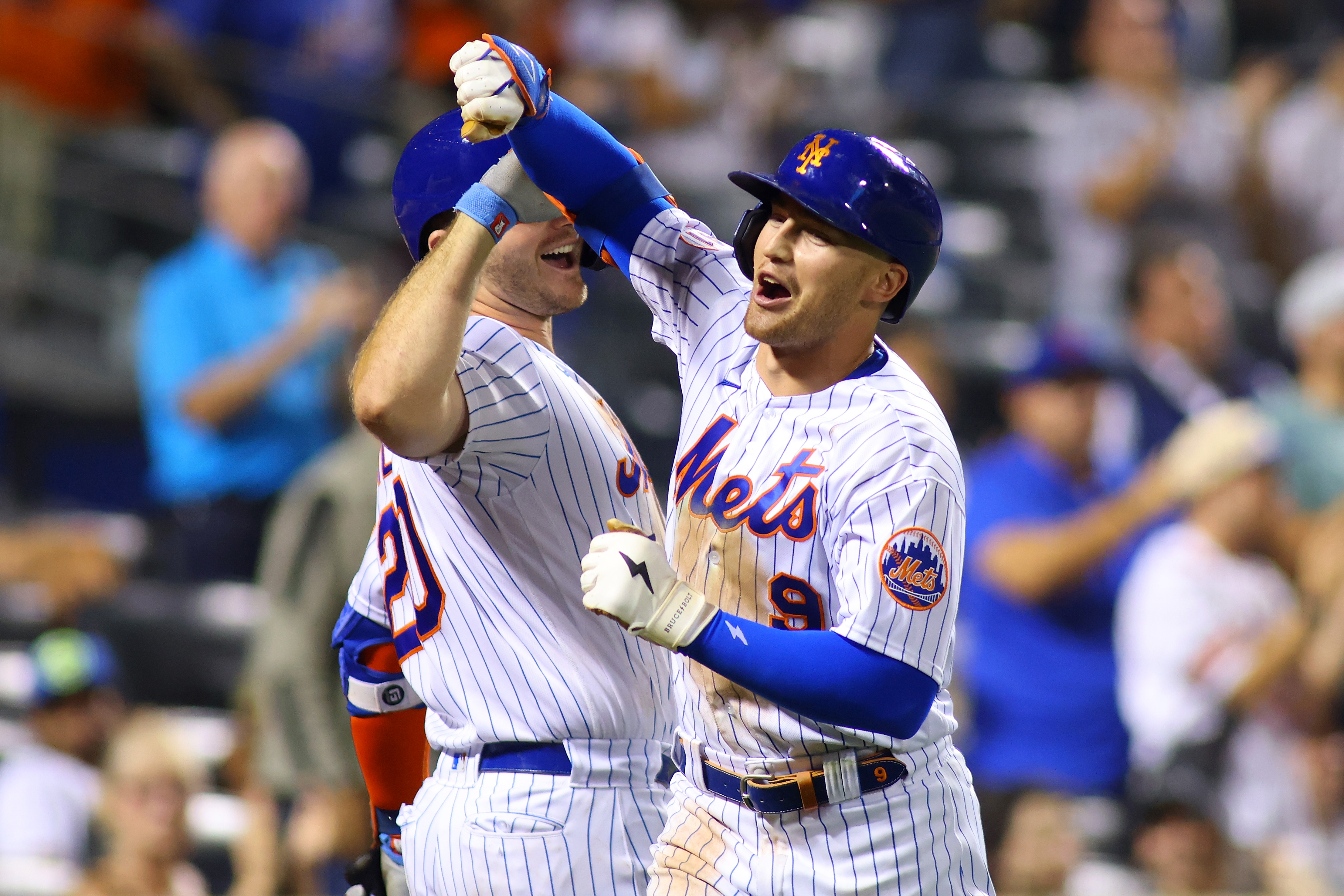 Brandon Nimmo of the New York Mets celebrates with Pete Alonso after hitting a home run in the eighth inning against the Philadelphia Phillies at Citi Field on September 18, 2021 in New York City.