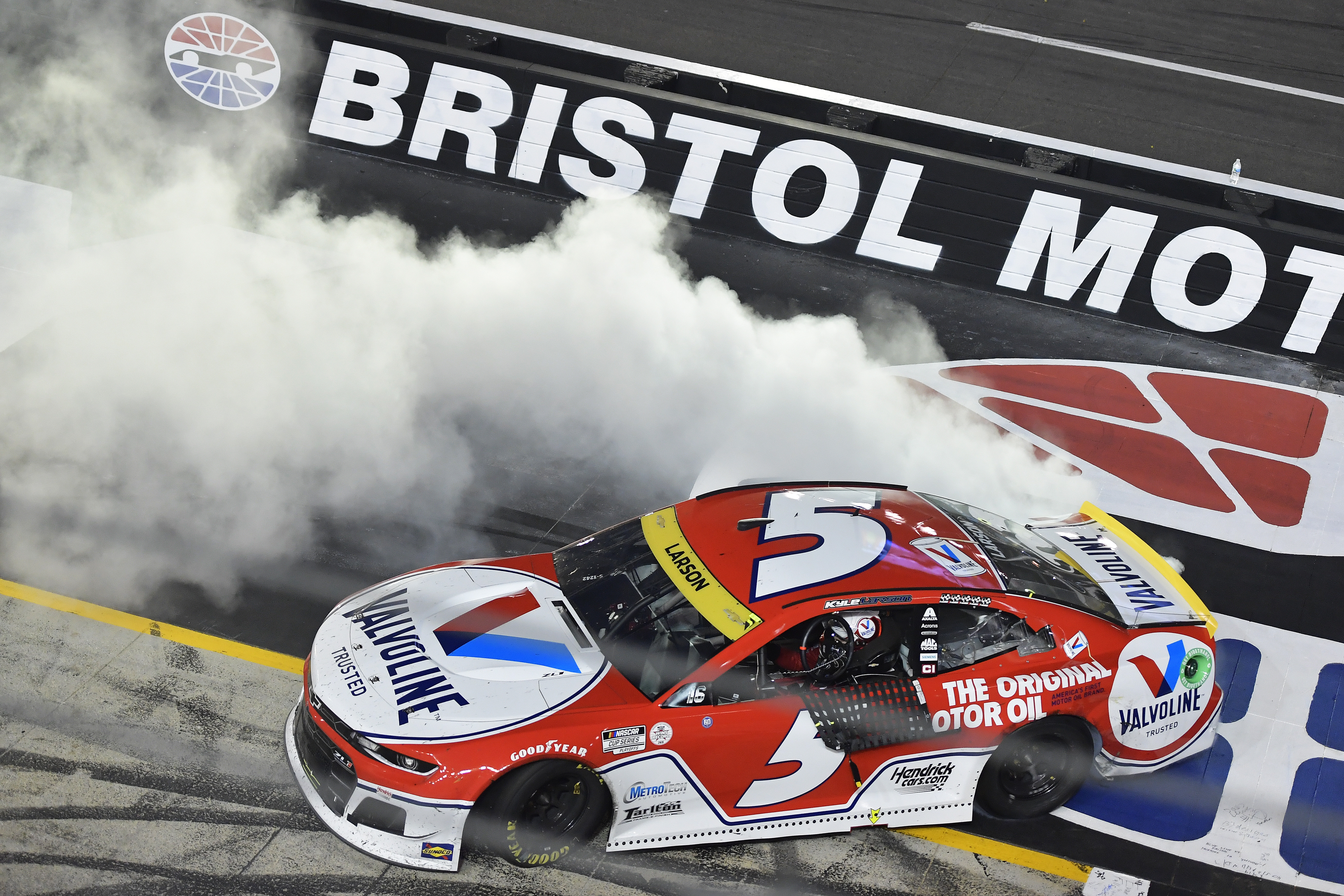 Kyle Larson, driver of the #5 Valvoline Chevrolet, celebrates with a burnout after winning the NASCAR Cup Series Bass Pro Shops Night Race at Bristol Motor Speedway on September 18, 2021 in Bristol, Tennessee.