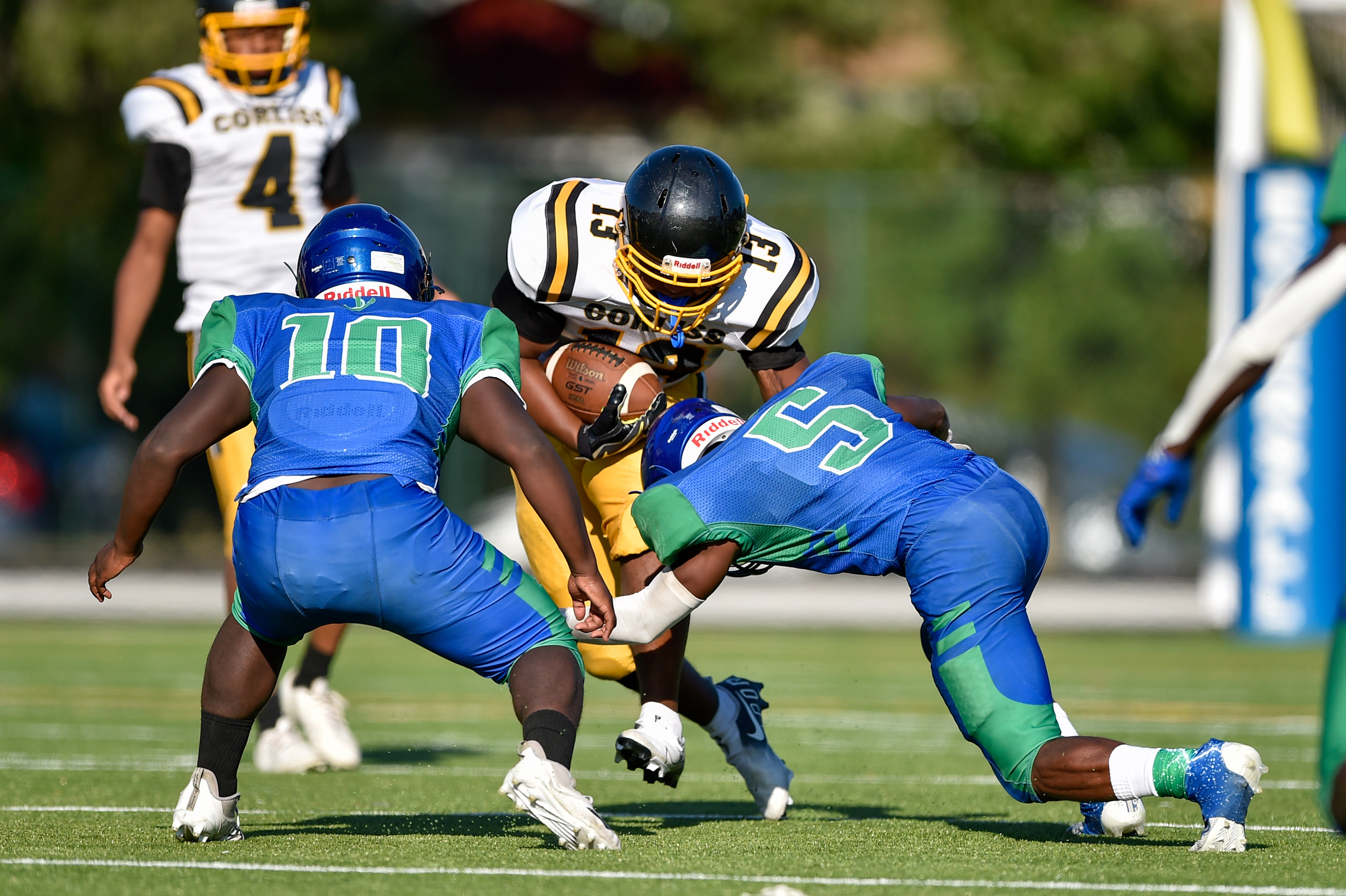 Corliss' Malachi Smith (13) is tackled by South Shore's Kristian Nelson (5) and Justin Norris (10).