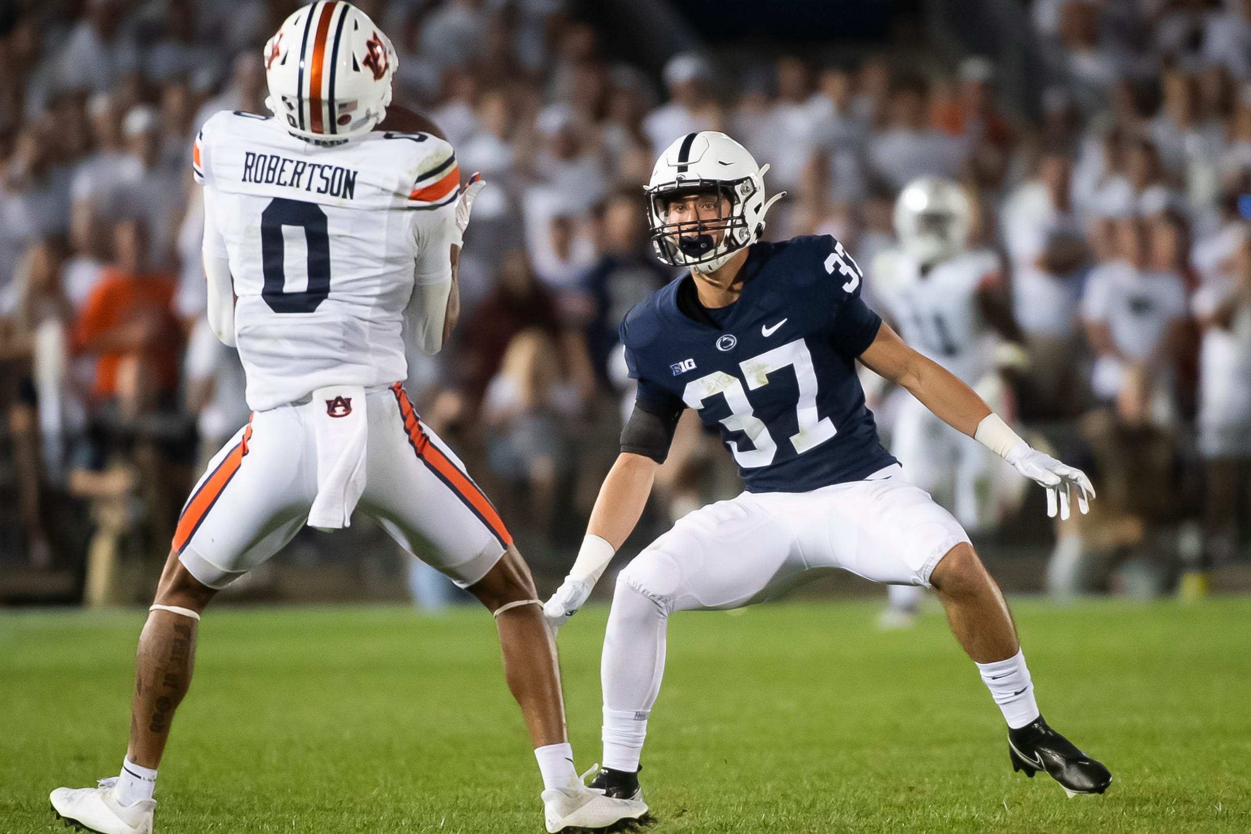 Penn State gunner Drew Hartlaub is the first Nittany Lion down the field to cover a punt return by Auburn's Demetris Robertson in the fourth quarter at Beaver Stadium on Saturday, Sept. 18, 2021, in State College. Robertson signaled and completed a fair catch.