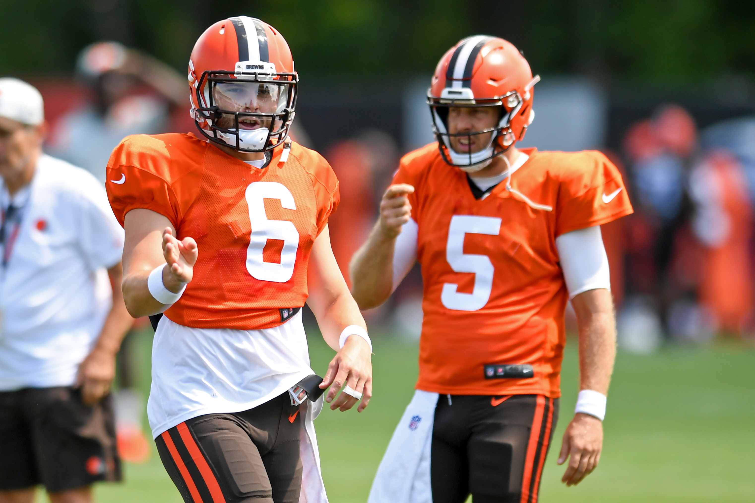 Quarterbacks Baker Mayfield #6 and Case Keenum #5 of the Cleveland Browns run a drill during Cleveland Browns Training Camp on August 3, 2021 in Berea, Ohio.