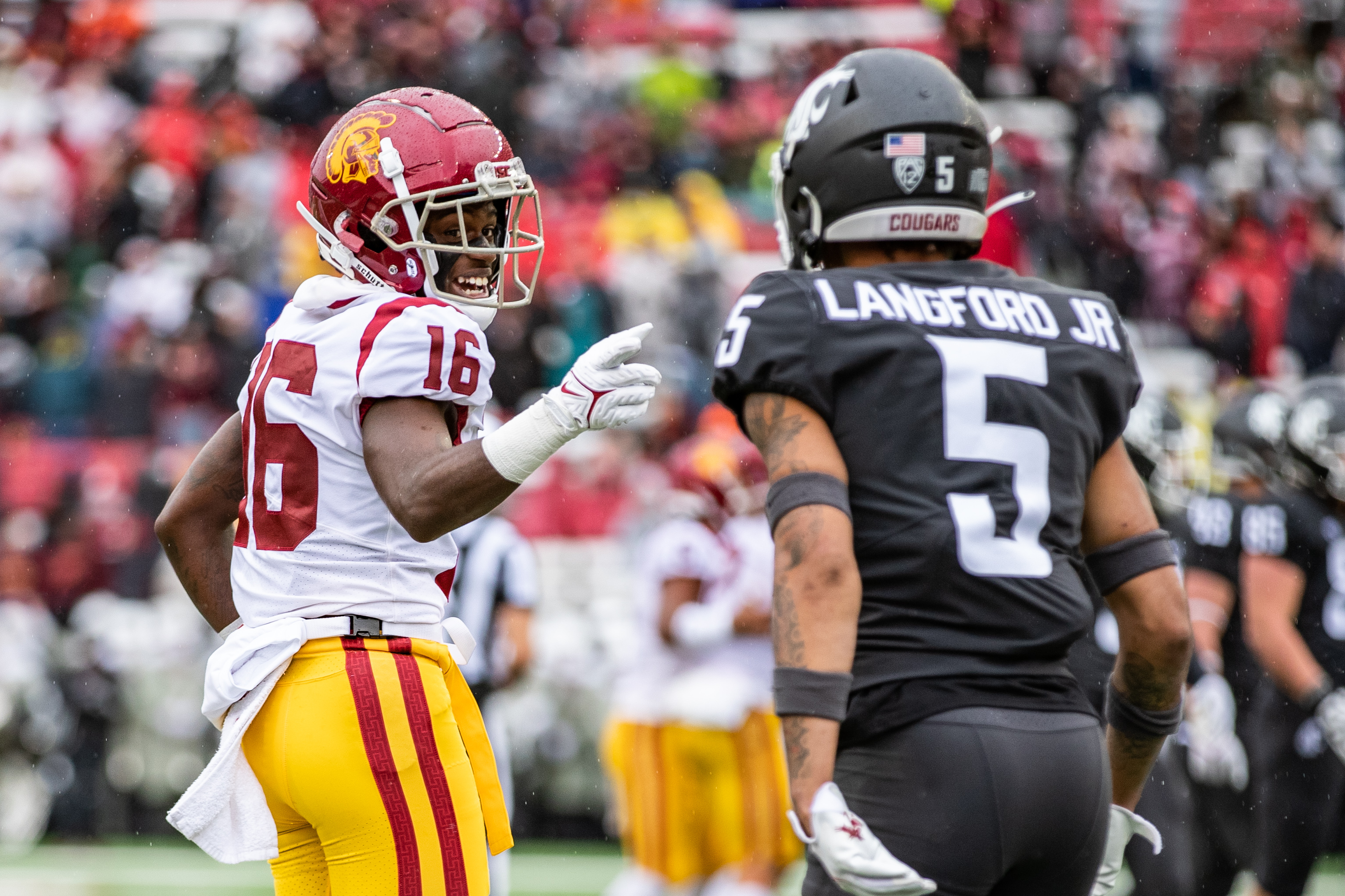 PULLMAN, WA - SEPTEMBER 18: Washington State cornerback Derrick Langford (5) chirps with a USC receiver during the first half of a PAC 12 conference matchup between the USC Trojans and the Washington State Cougars on September 18, 2021, at Martin Stadium in Pullman, WA.