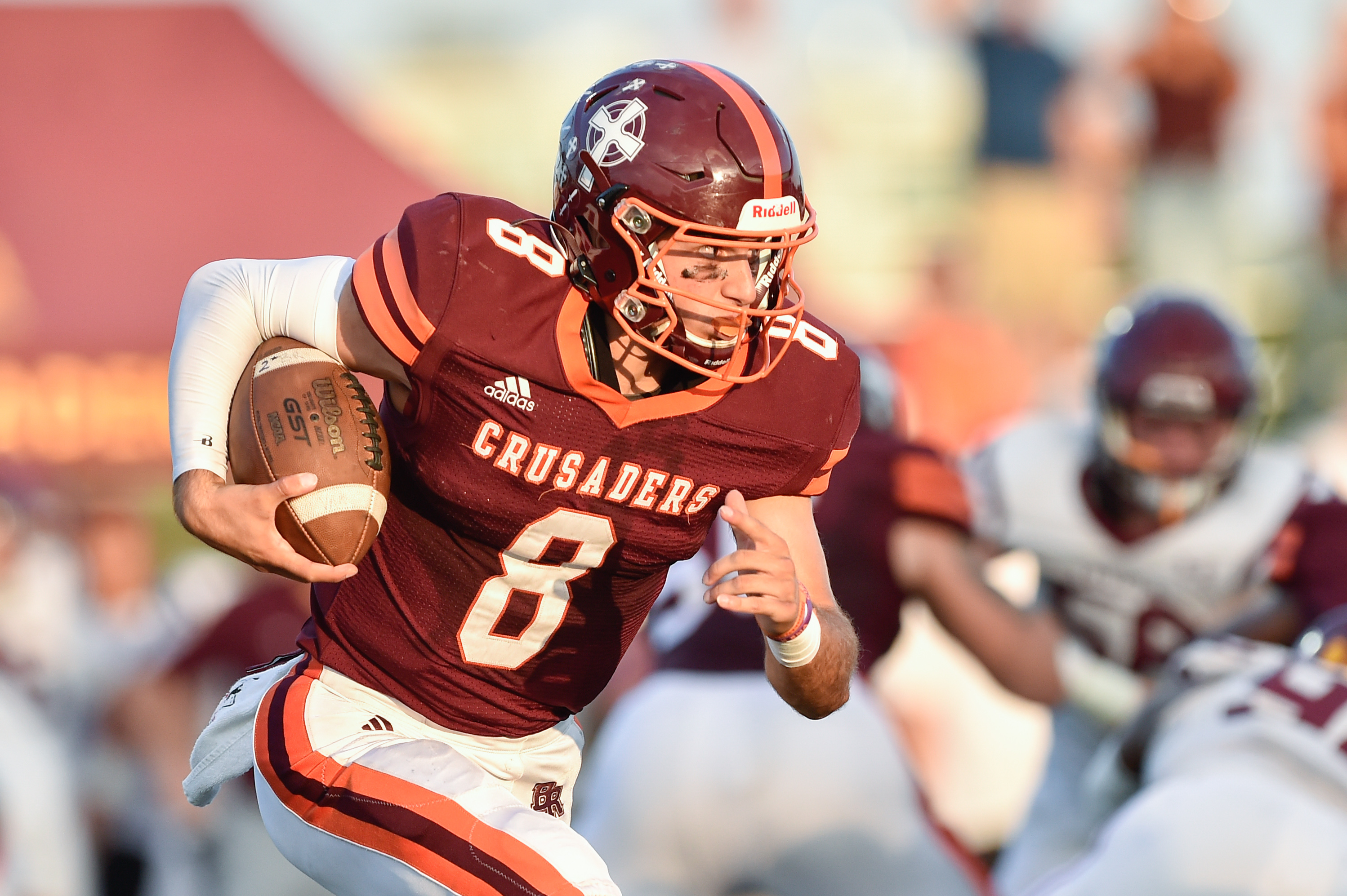 Brother Rice's Jack Lausch (8) runs the ball against Loyola.