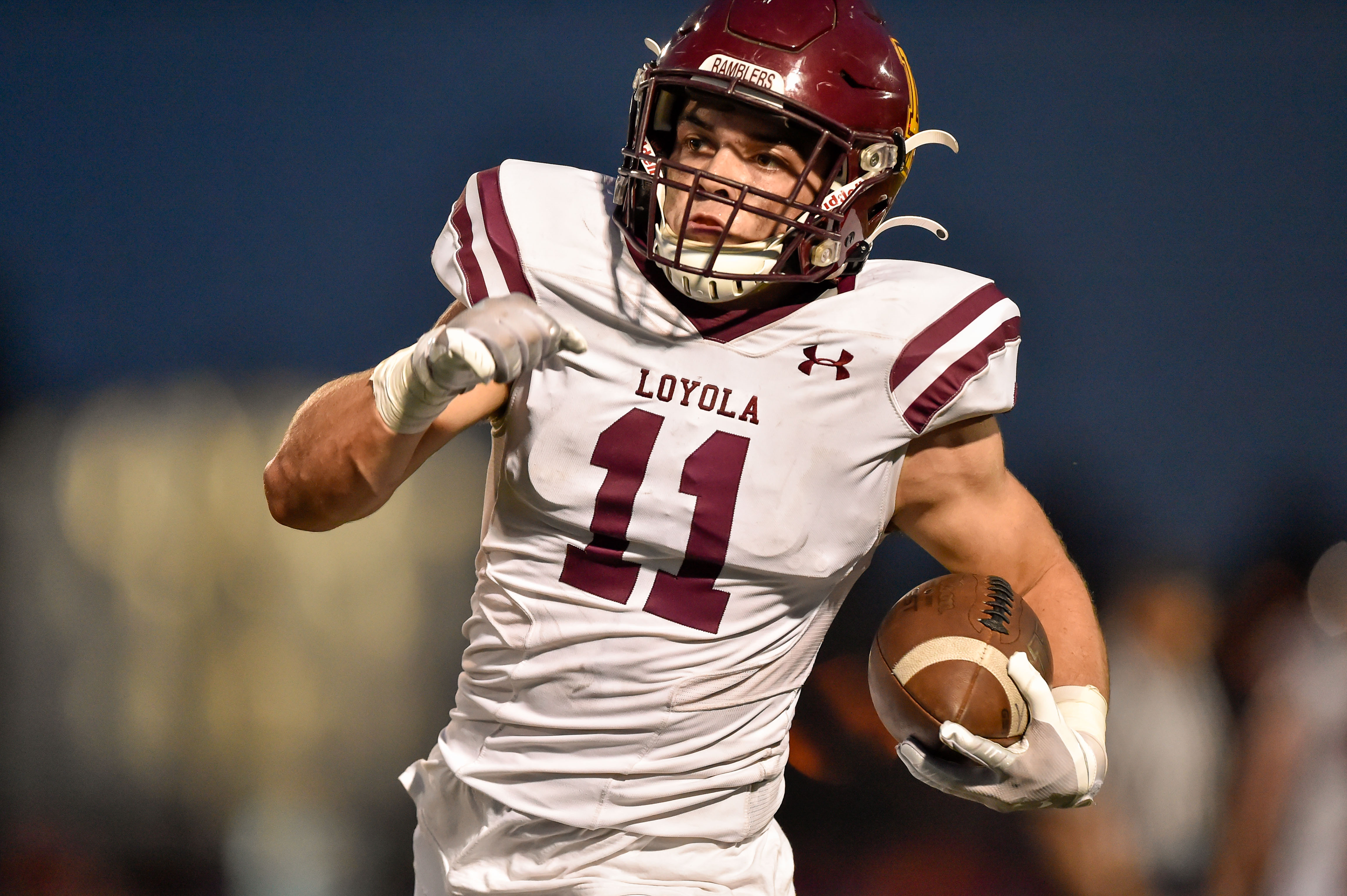 Loyola's Danny Collins (11) runs for a touchdown against Brother Rice.