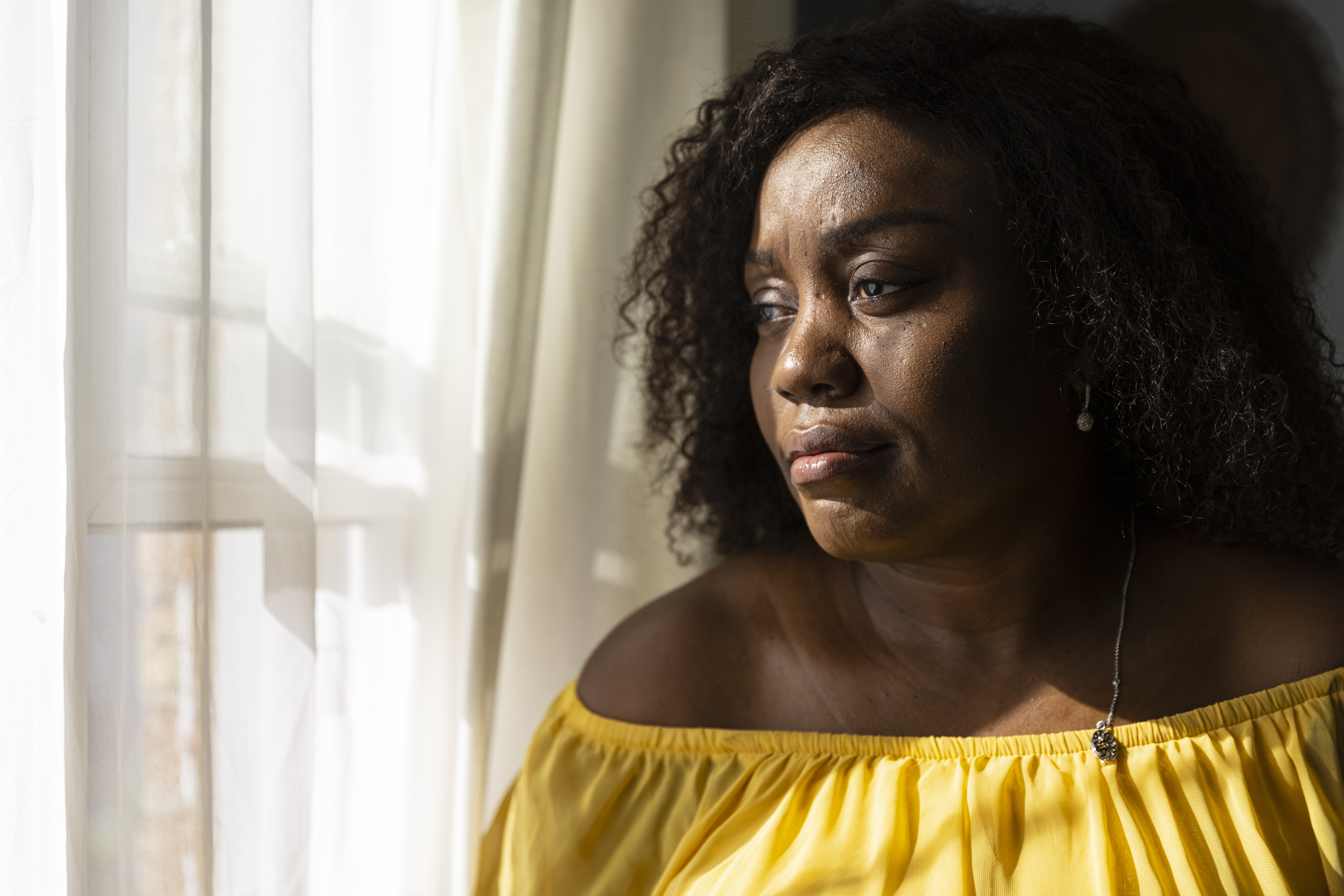 Beverly Chukwudozie at home in Evanston. She has battled to enjoy a full life despite the pain of sickle cell disease for as long as she can remember.