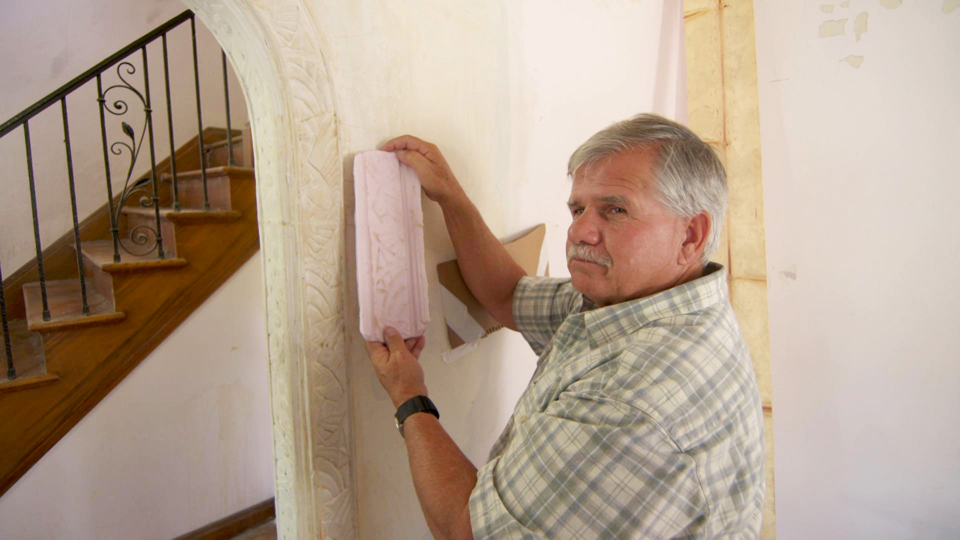 Tom Silva with molding at the Detroit house