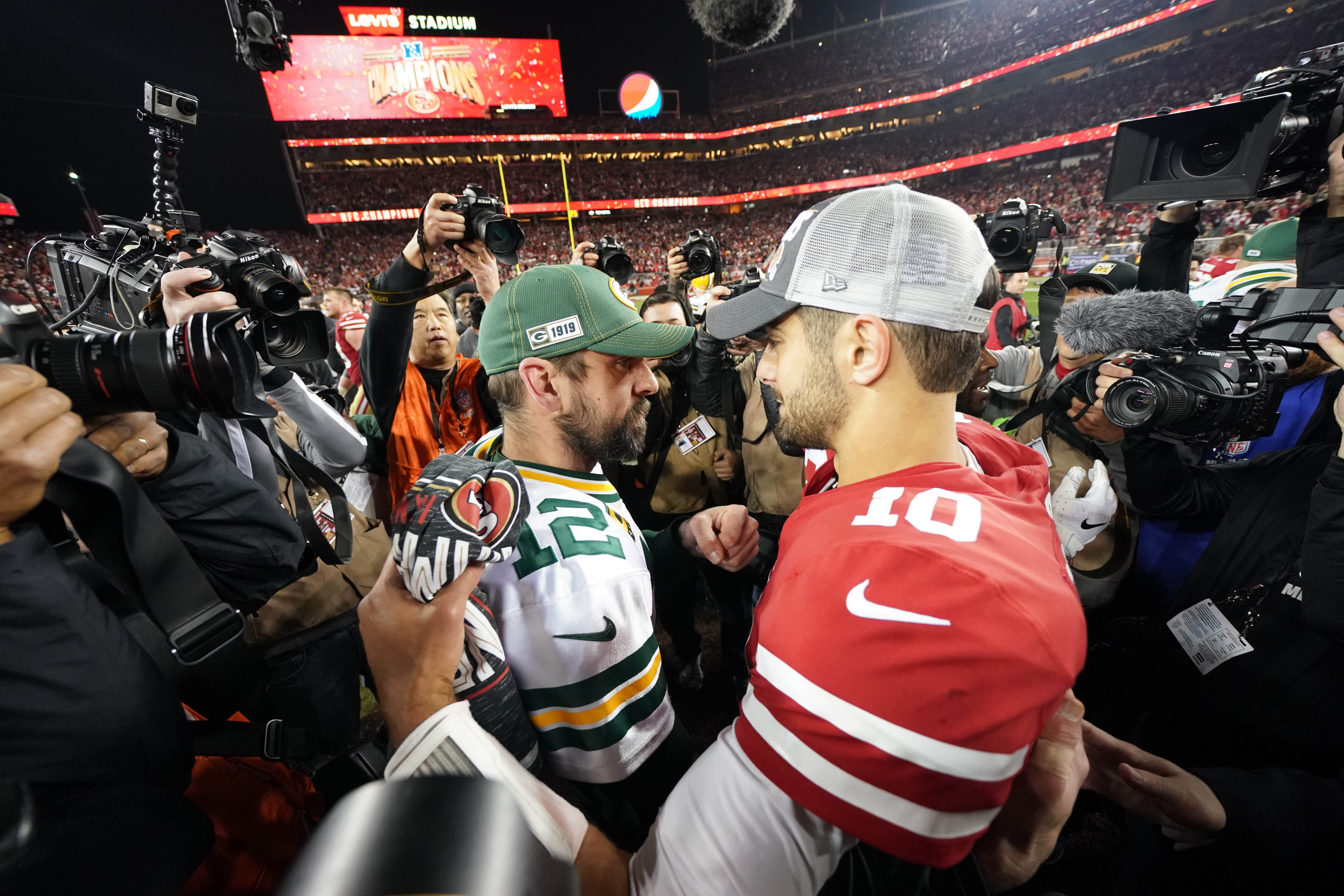 Green Bay Packers quarterback Aaron Rodgers (12) greets San Francisco 49ers quarterback Jimmy Garoppolo (10) after the NFC Championship Game at Levi's Stadium.