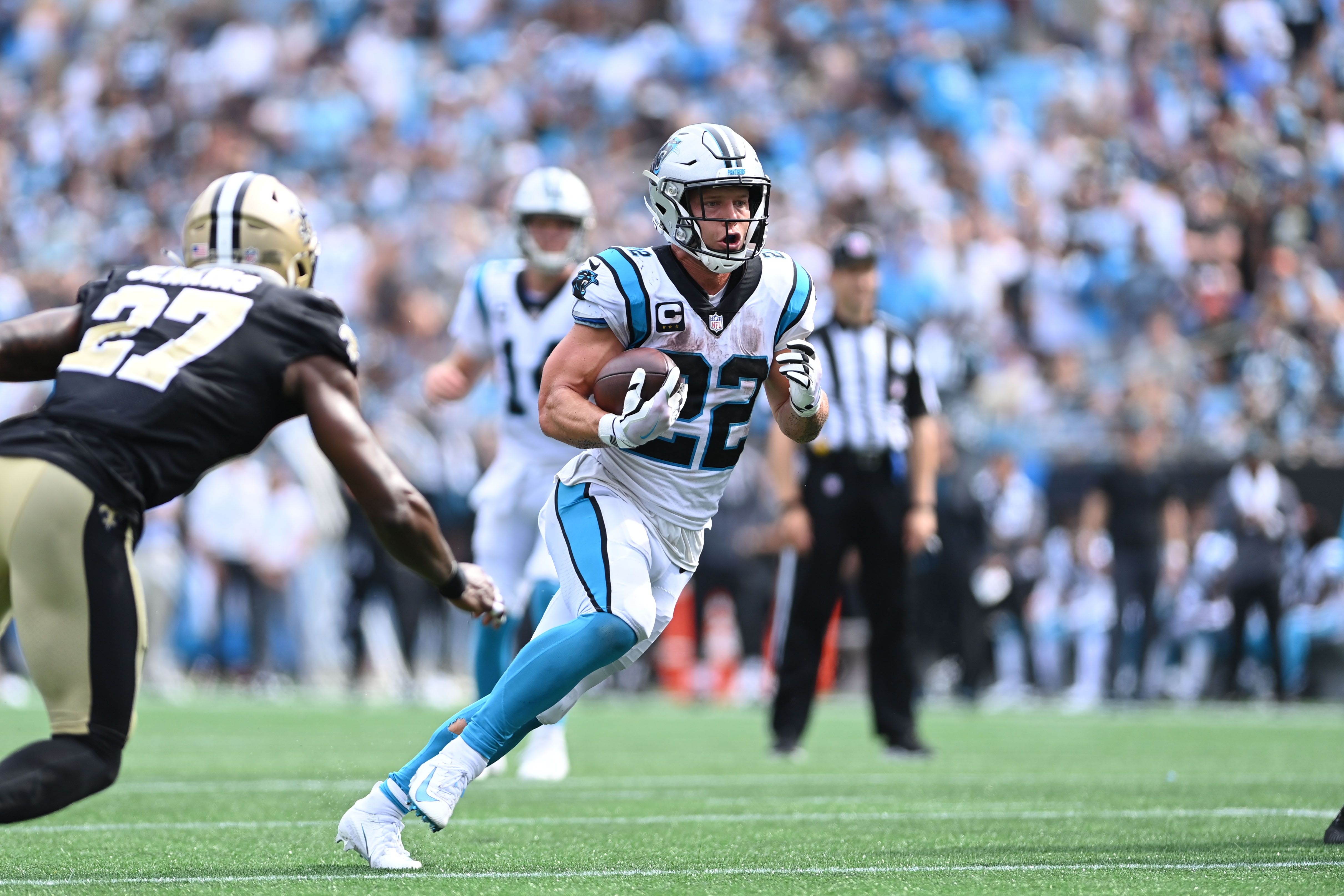 Carolina Panthers running back Christian McCaffrey (22) runs for a touchdown as New Orleans Saints strong safety Malcolm Jenkins (27) defends in the fourth quarter at Bank of America Stadium.