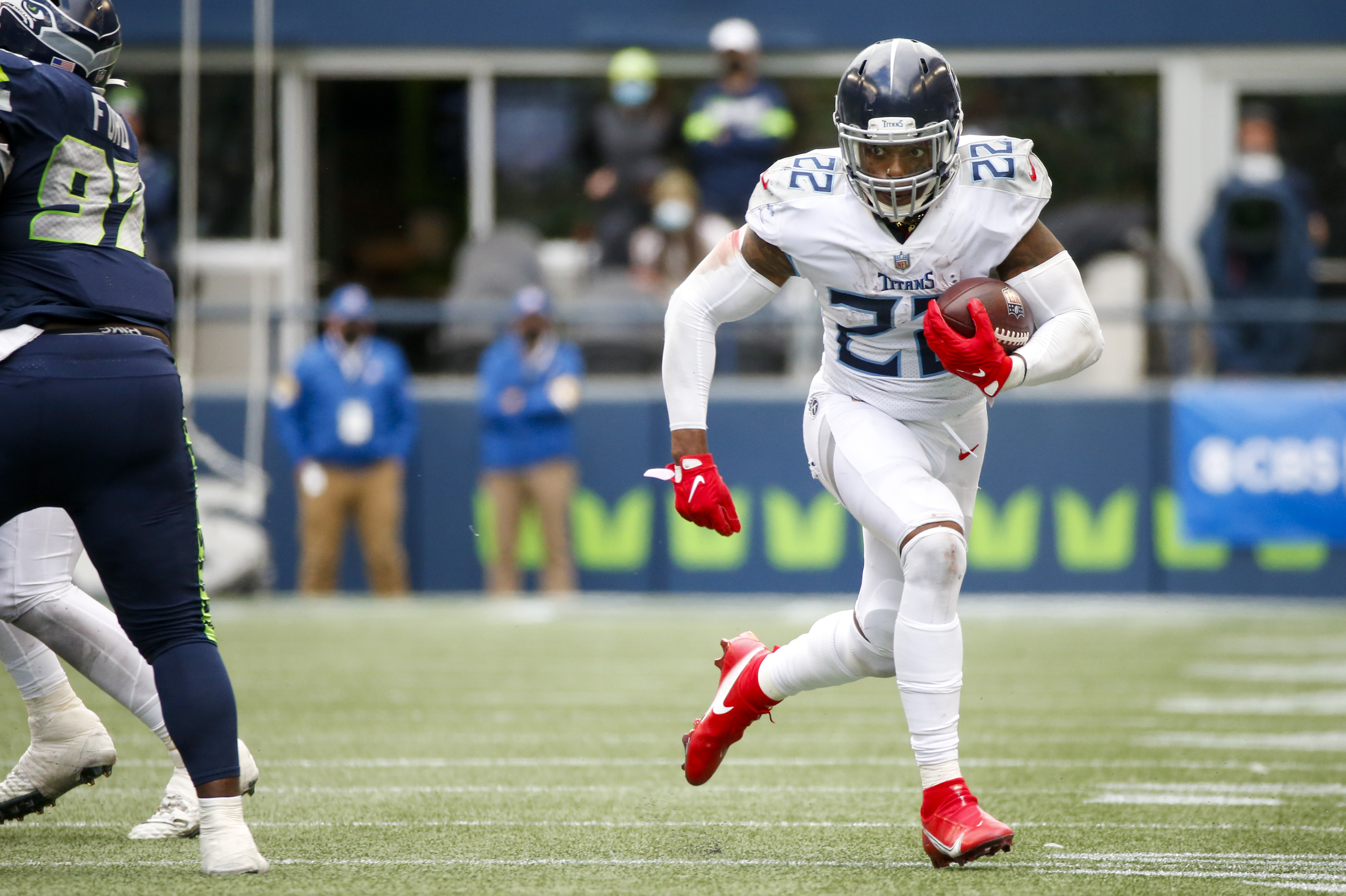 Tennessee Titans running back Derrick Henry (22) rushes against the Seattle Seahawks during overtime at Lumen Field.