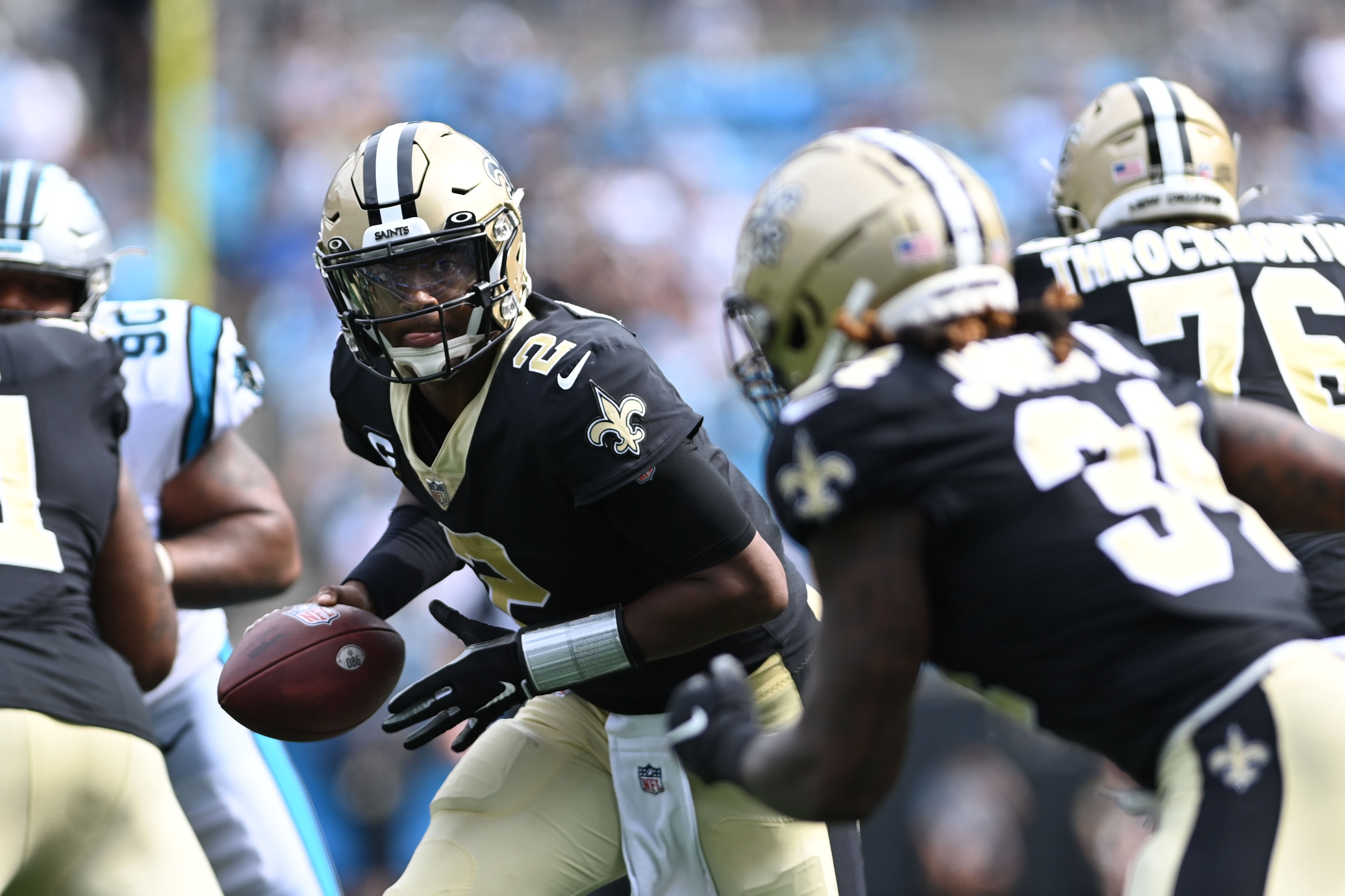 New Orleans Saints quarterback Jameis Winston (2) hands off to running back Tony Jones Jr. (34) in the fourth quarter at Bank of America Stadium.
