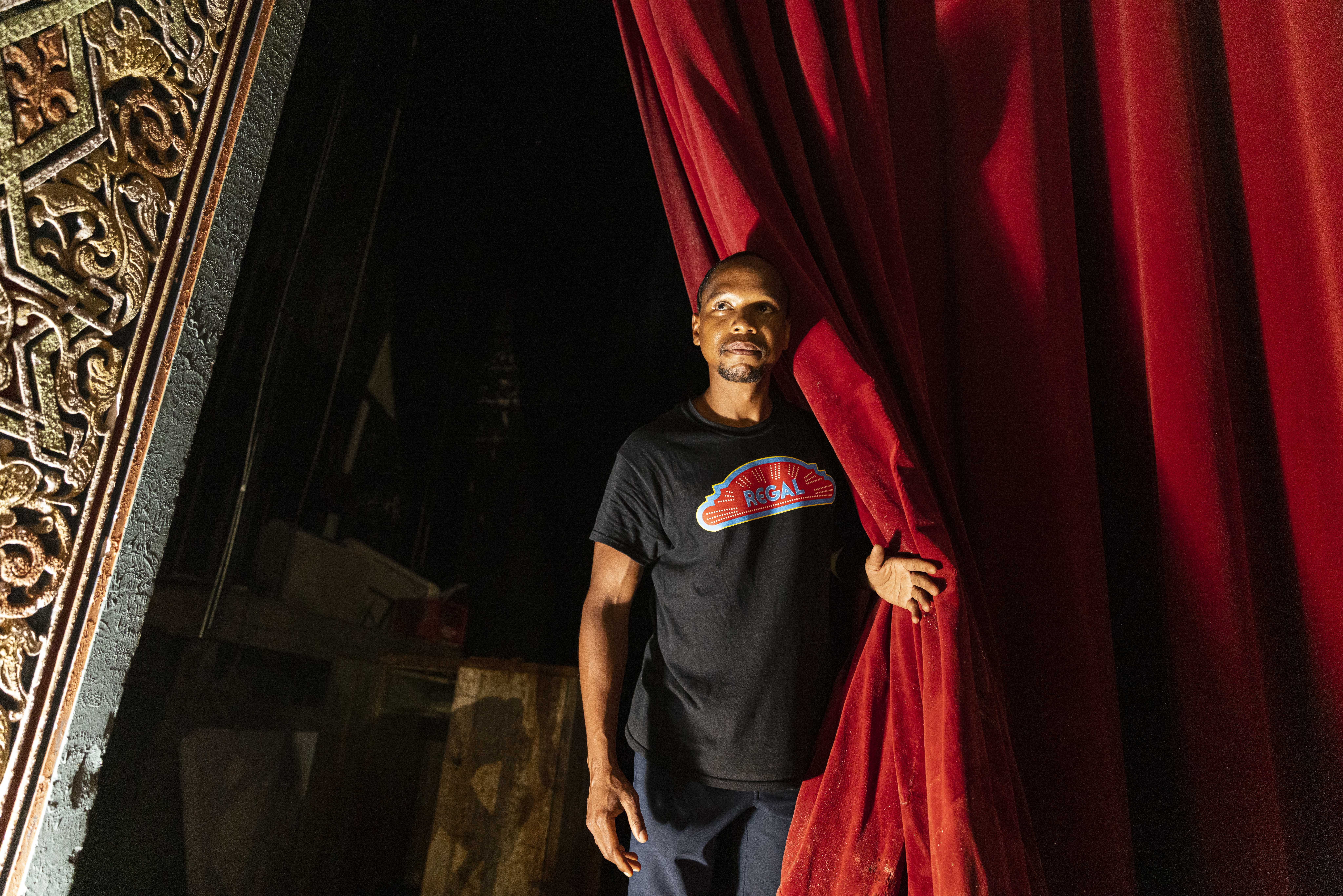 Owner Jerald Gary peers from the stage at the Avalon Regal Theater, 1641 E. 79th St.