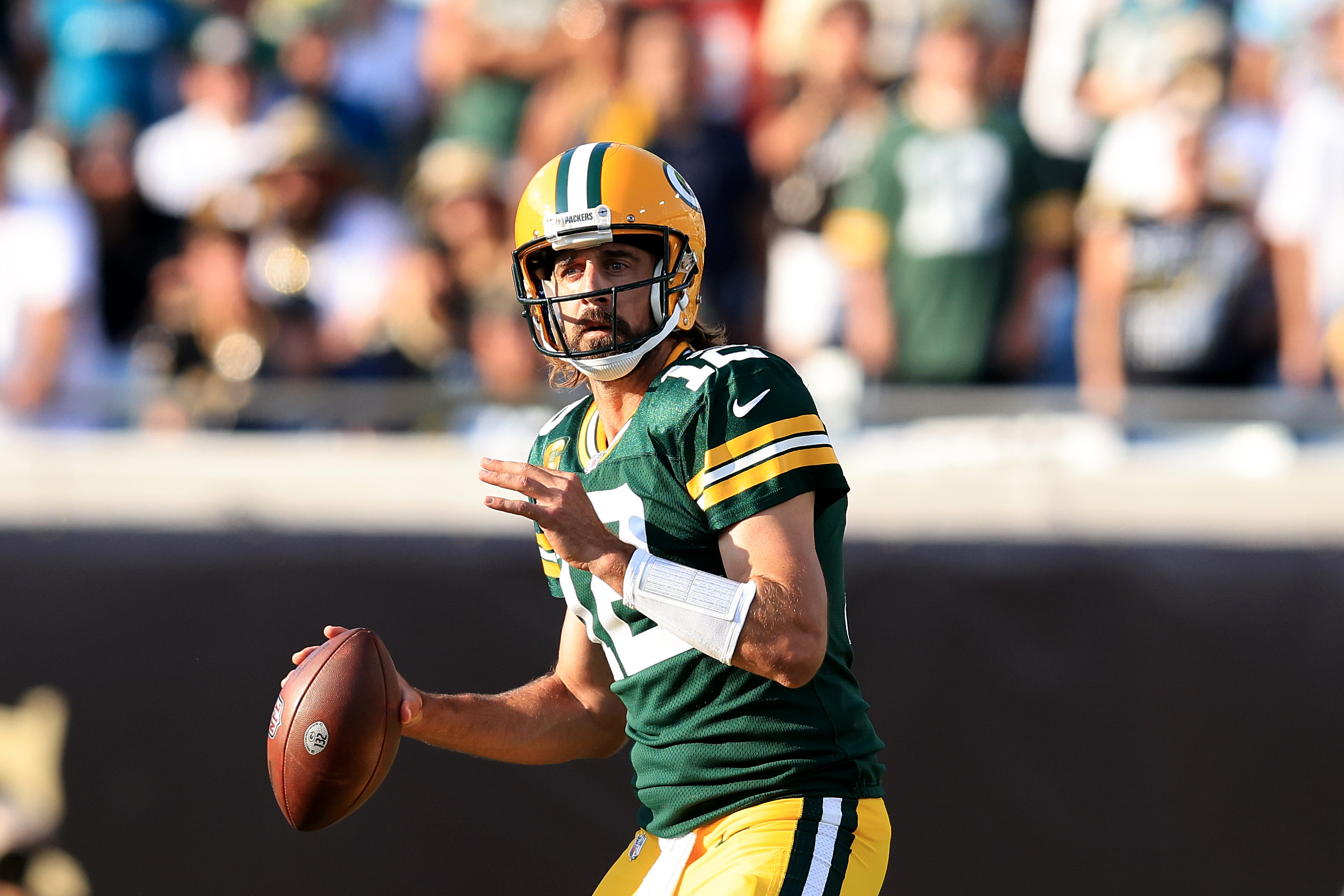 Aaron Rodgers #12 of the Green Bay Packers looks to pass during the game against the New Orleans Saints at TIAA Bank Field on September 12, 2021 in Jacksonville, Florida.