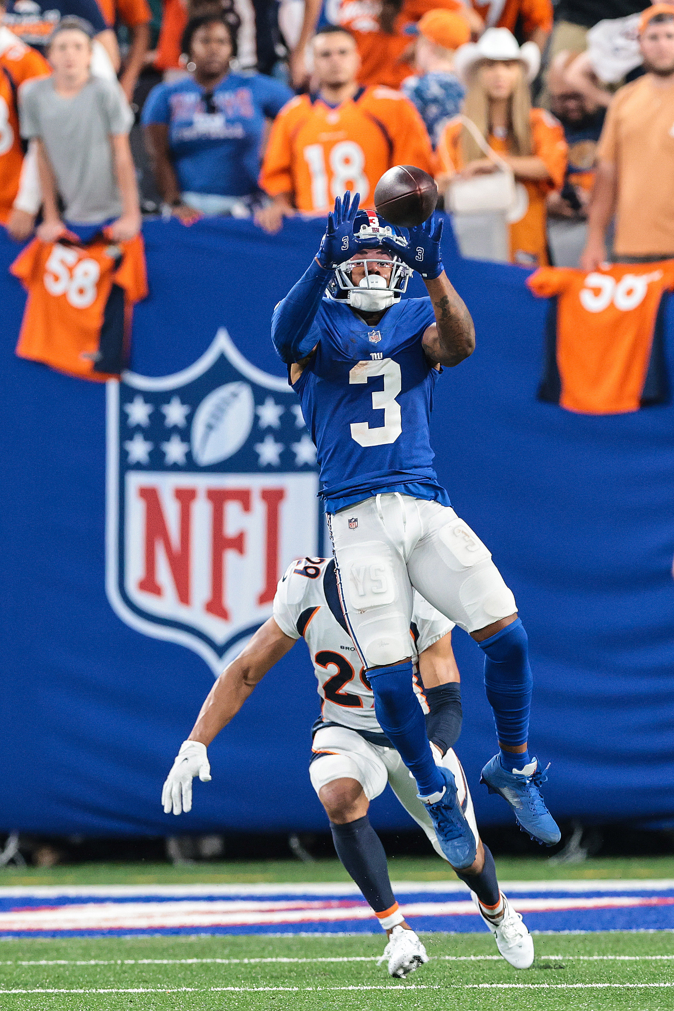 New York Giants wide receiver Sterling Shepard (3) catches the ball over Denver Broncos cornerback Bryce Callahan (29) during the second half at MetLife Stadium.