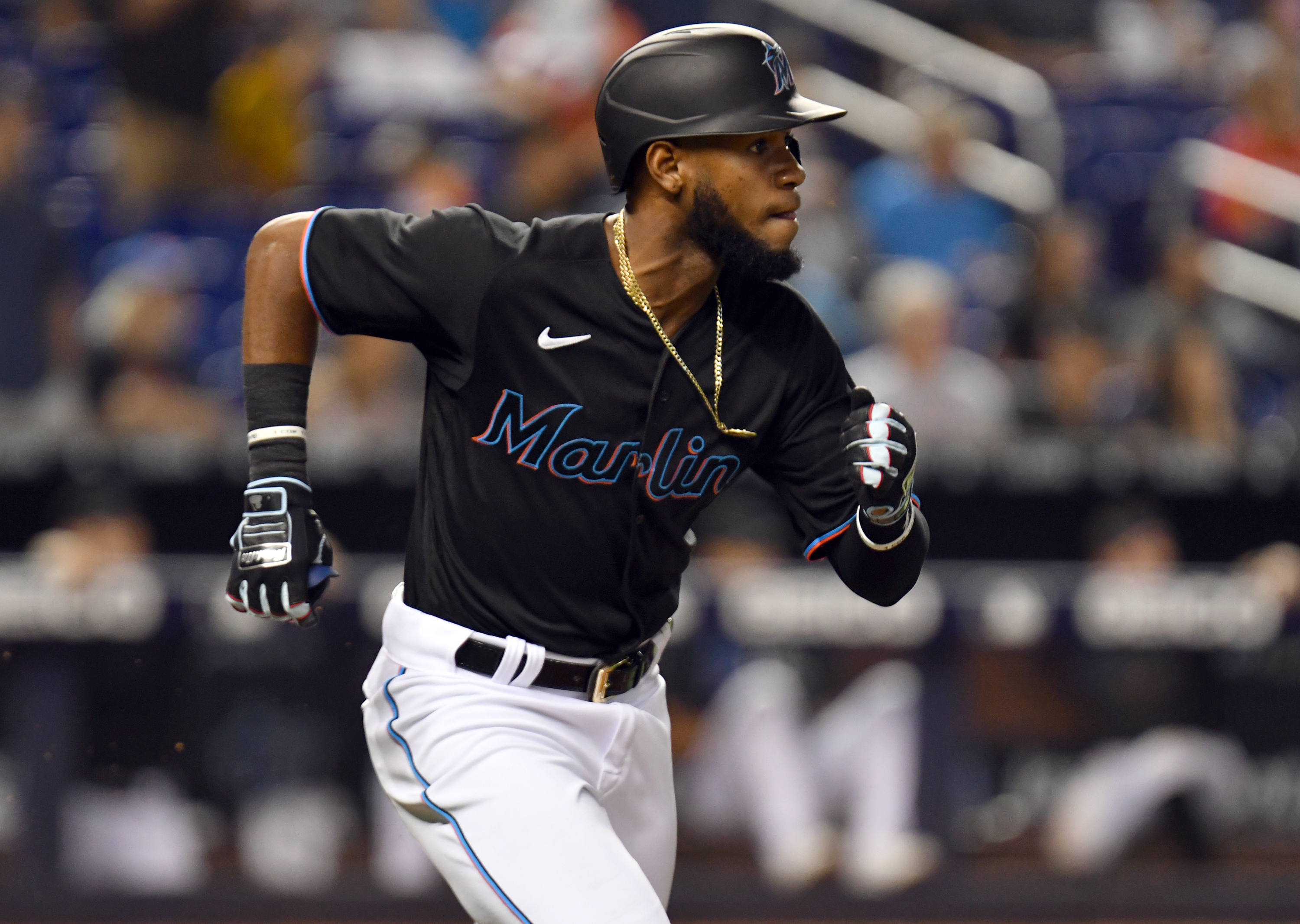 Miami Marlins right fielder Bryan De La Cruz (77) runs out a triple against the Pittsburgh Pirates during the ninth inning at loanDepot Park