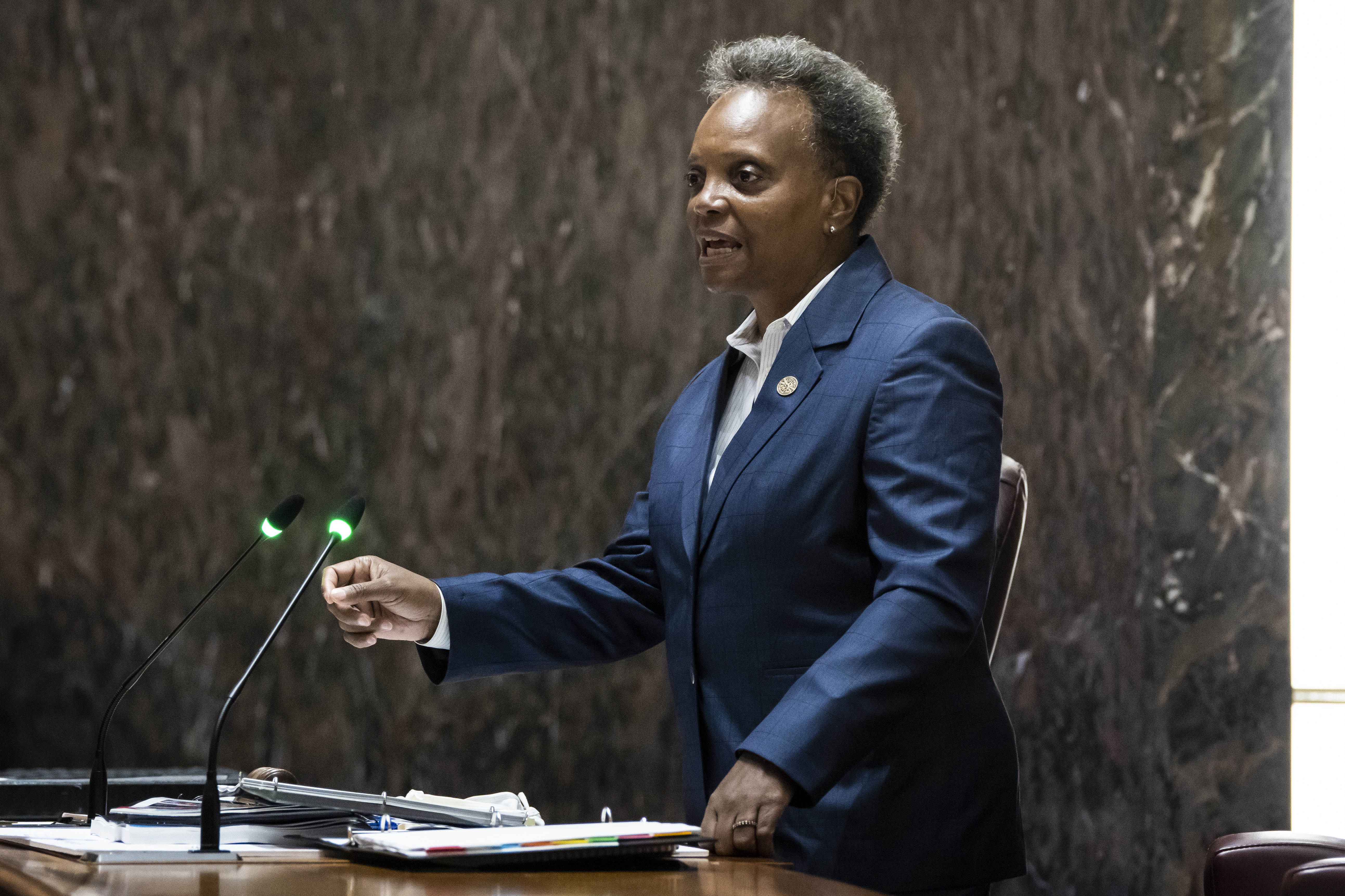 Mayor Lori Lightfoot delivers the city's 2022 budget proposal during a Chicago City Council meeting at City Hall Monday morning.
