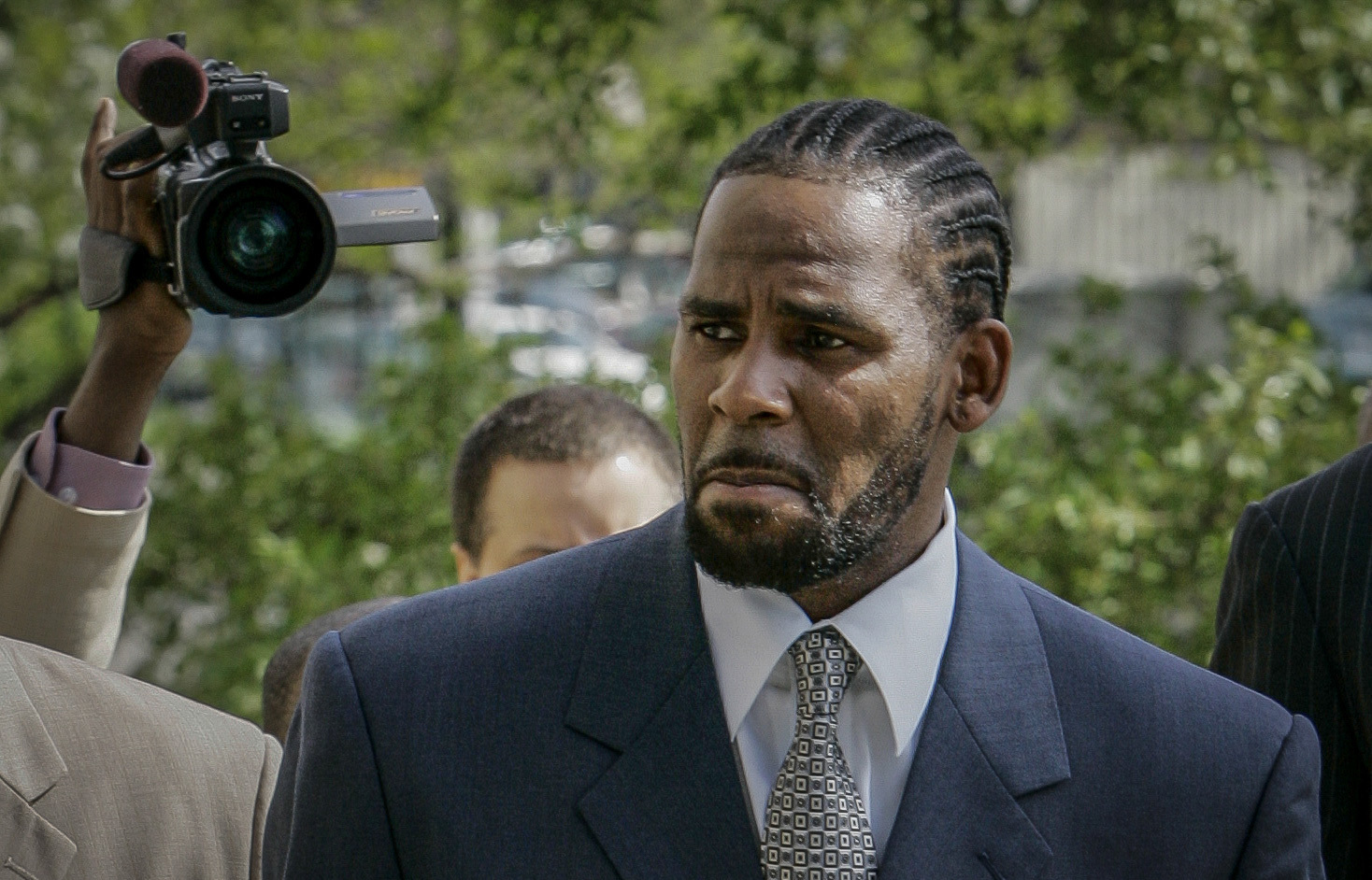 R. Kelly arriving for the first day of jury selection in his child pornography trial at the Cook County Criminal Courthouse in Chicago in May 2008.