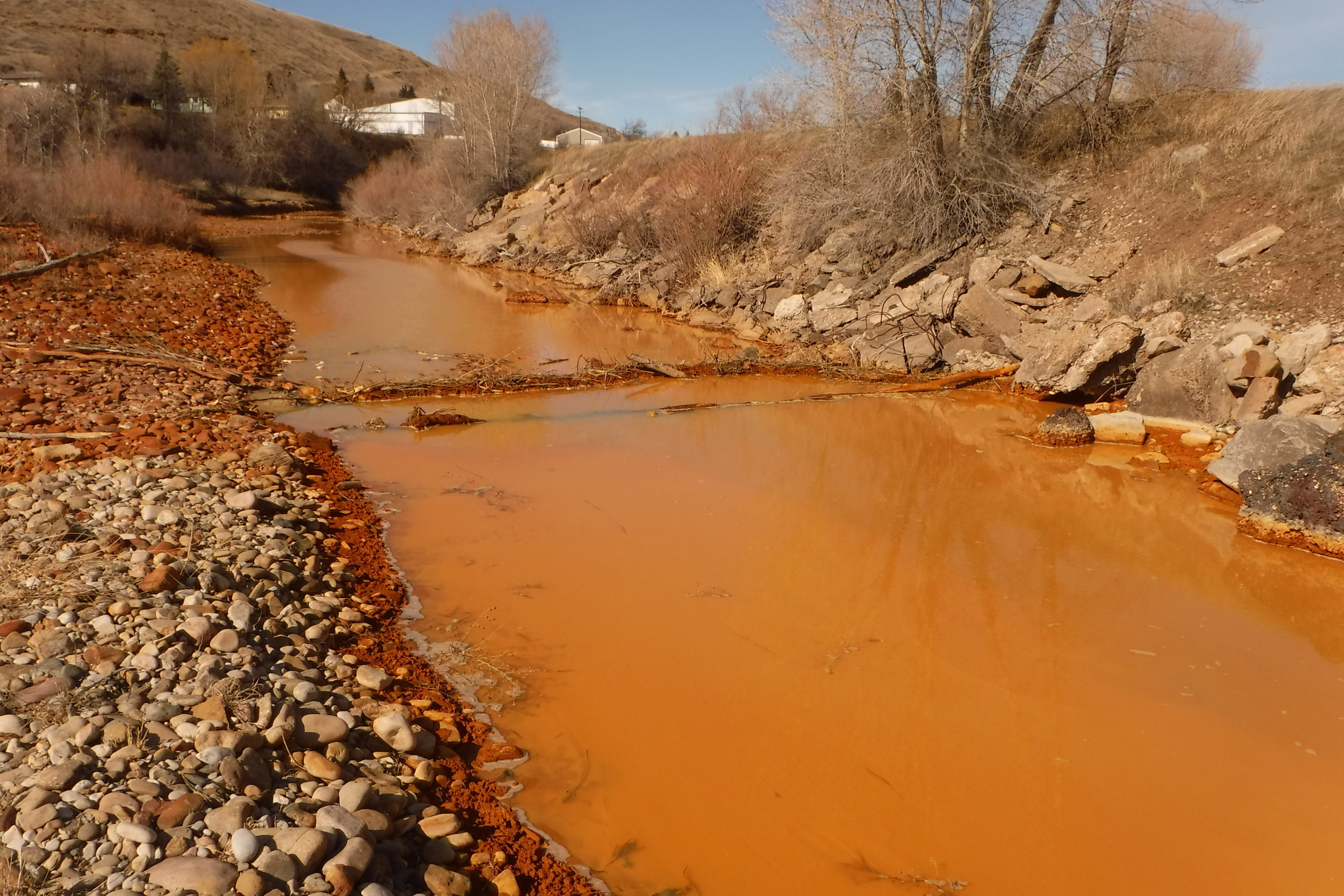 Polluted Belt Creek in Montana. The state plans to build a plant to treat acid mine drainage from an old coal mine that's Belt Creek, sometimes causing it to turn a rusty color and harming the trout fishery.