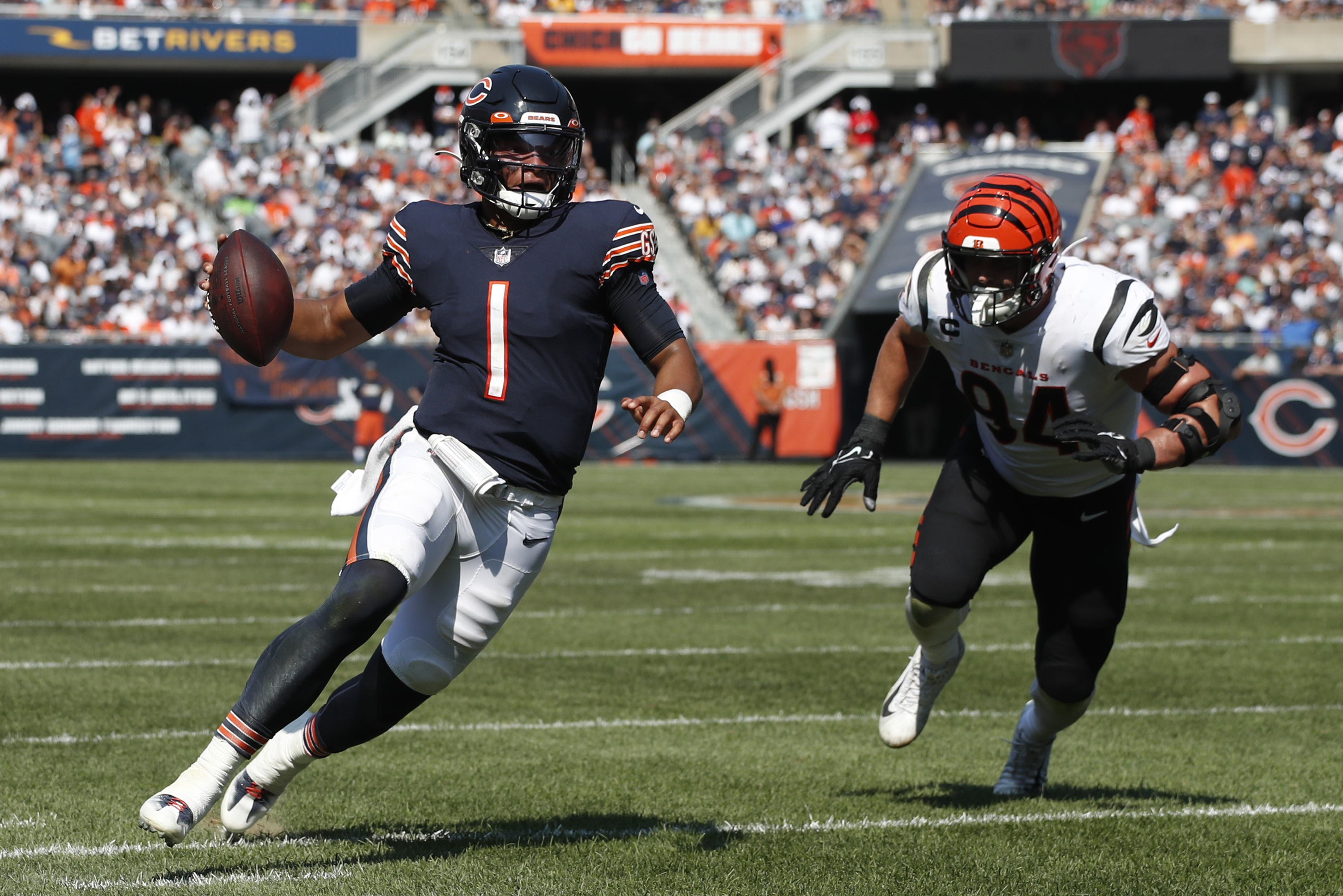 Bears rookie quarterback Justin Fields (1) gained 35 yards on seven carries against the Bengals on. Sunday, not including three kneel-downs in the final 1:54.
