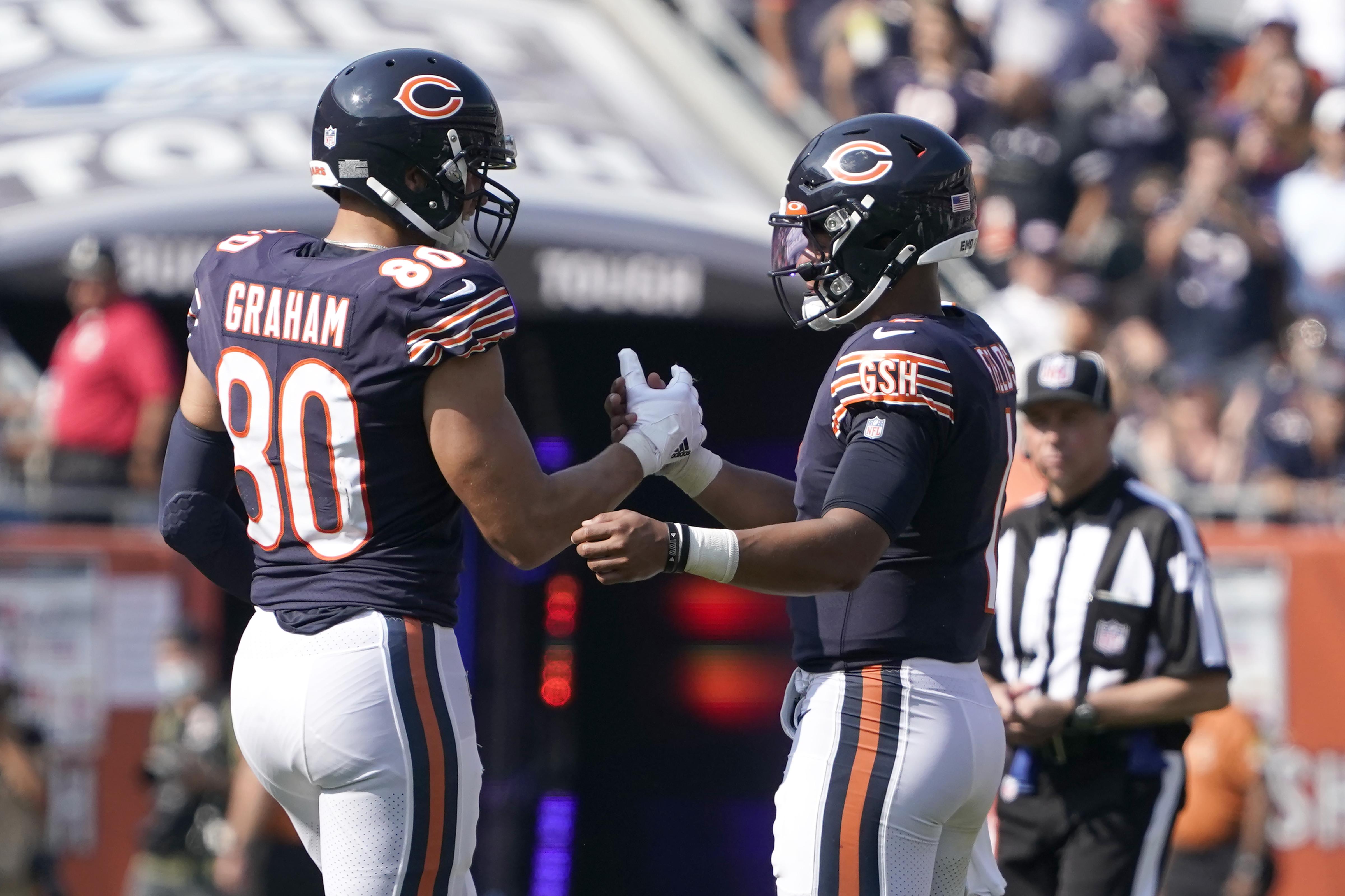Bears tight end Jimmy Graham talks to quarterback Justin Fields on Sunday.