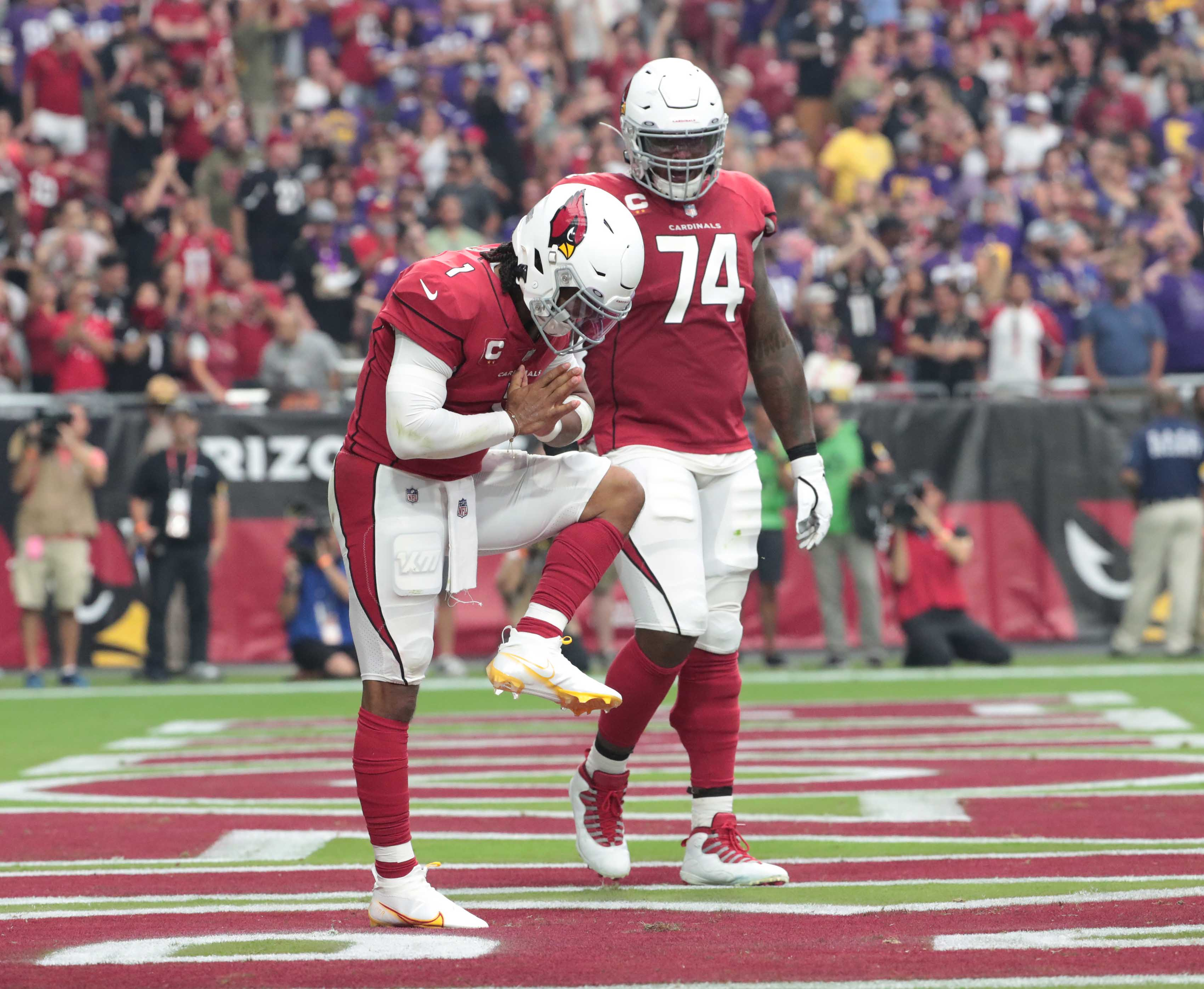 Arizona Cardinals quarterback Kyler Murray (1) bows after a touchdown run against the Minnesota Vikings during the second quarter in Glendale, Ariz. Sept. 19, 2021.