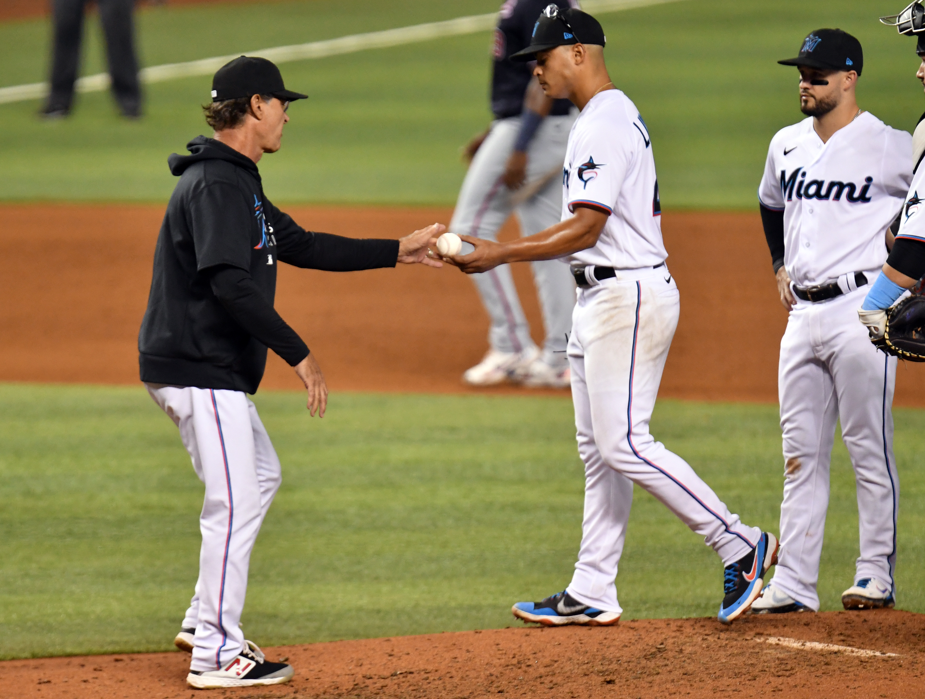 Miami Marlins manager Don Mattingly takes the ball from starting pitcher Jesus Luzardo (44) during the fifth inning against the Washington Nationals at loanDepot Park