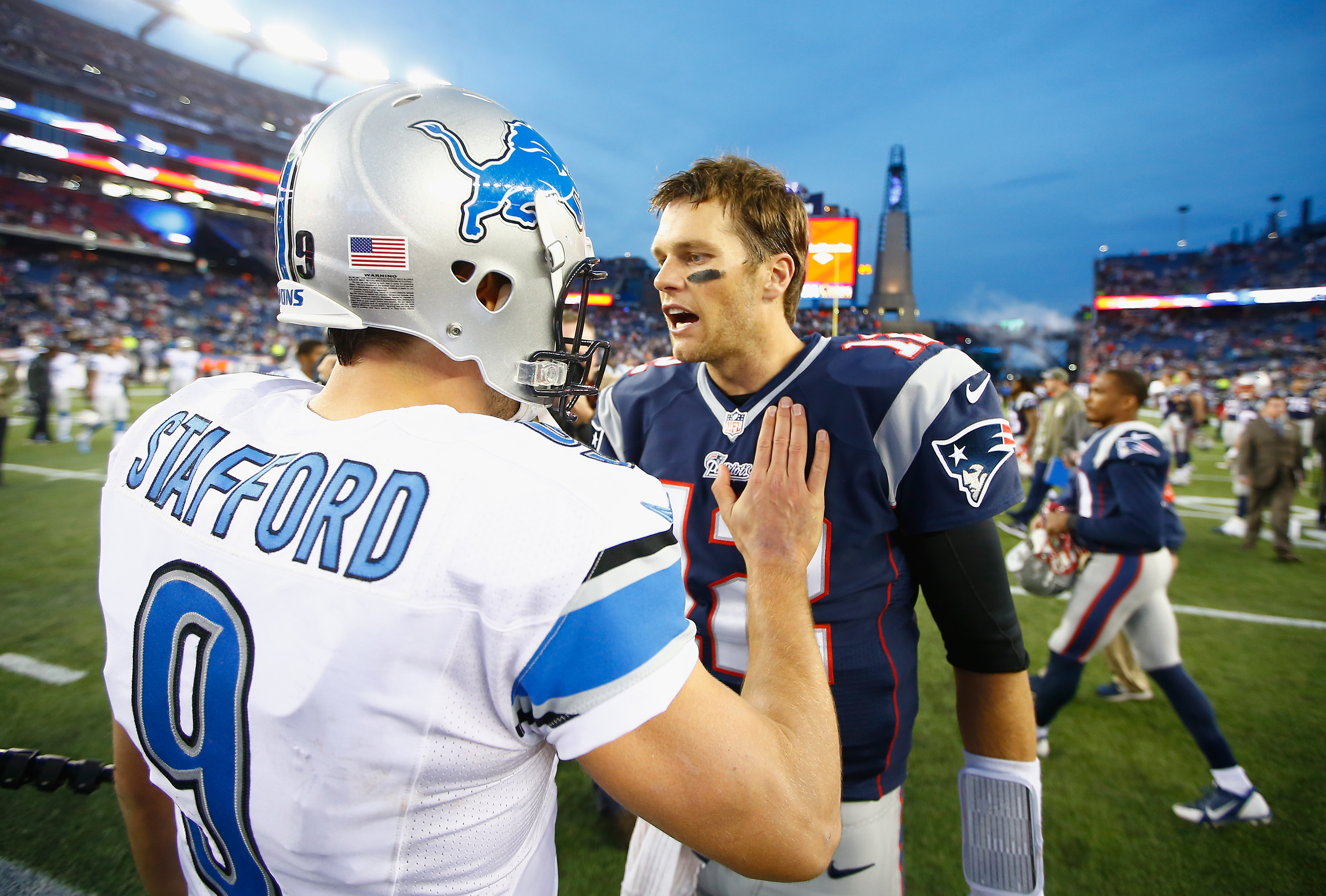 Tom Brady #12 of the New England Patriots shakes hands with Matthew Stafford #9 of the Detroit Lions after a game at Gillette Stadium on November 23, 2014 in Foxboro, Massachusetts.