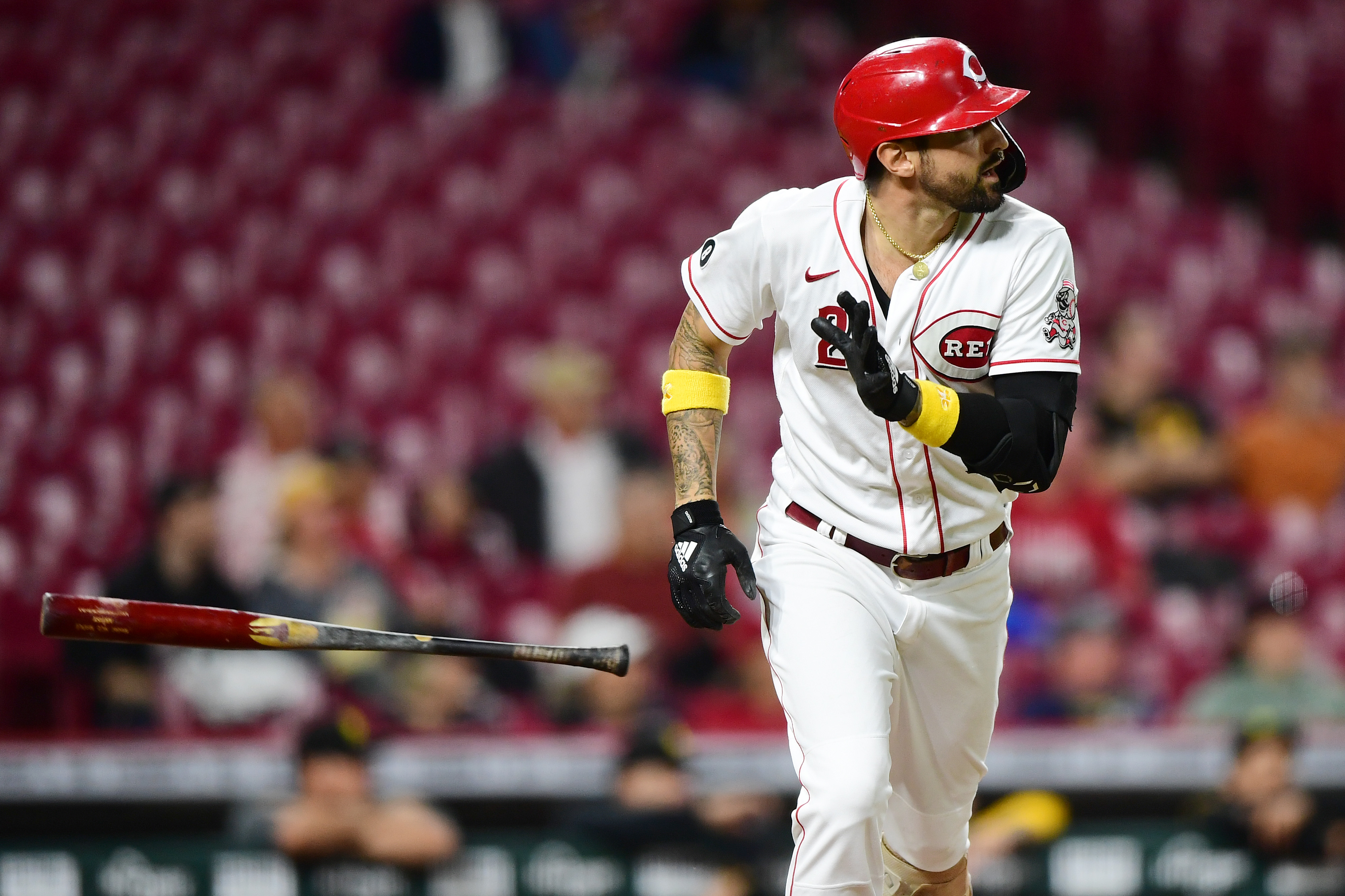 Nick Castellanos #2 of the Cincinnati Reds tosses his bat after hitting a two-RBI double in the third inning during their game against the Pittsburgh Pirates at Great American Ball Park on September 20, 2021 in Cincinnati, Ohio.