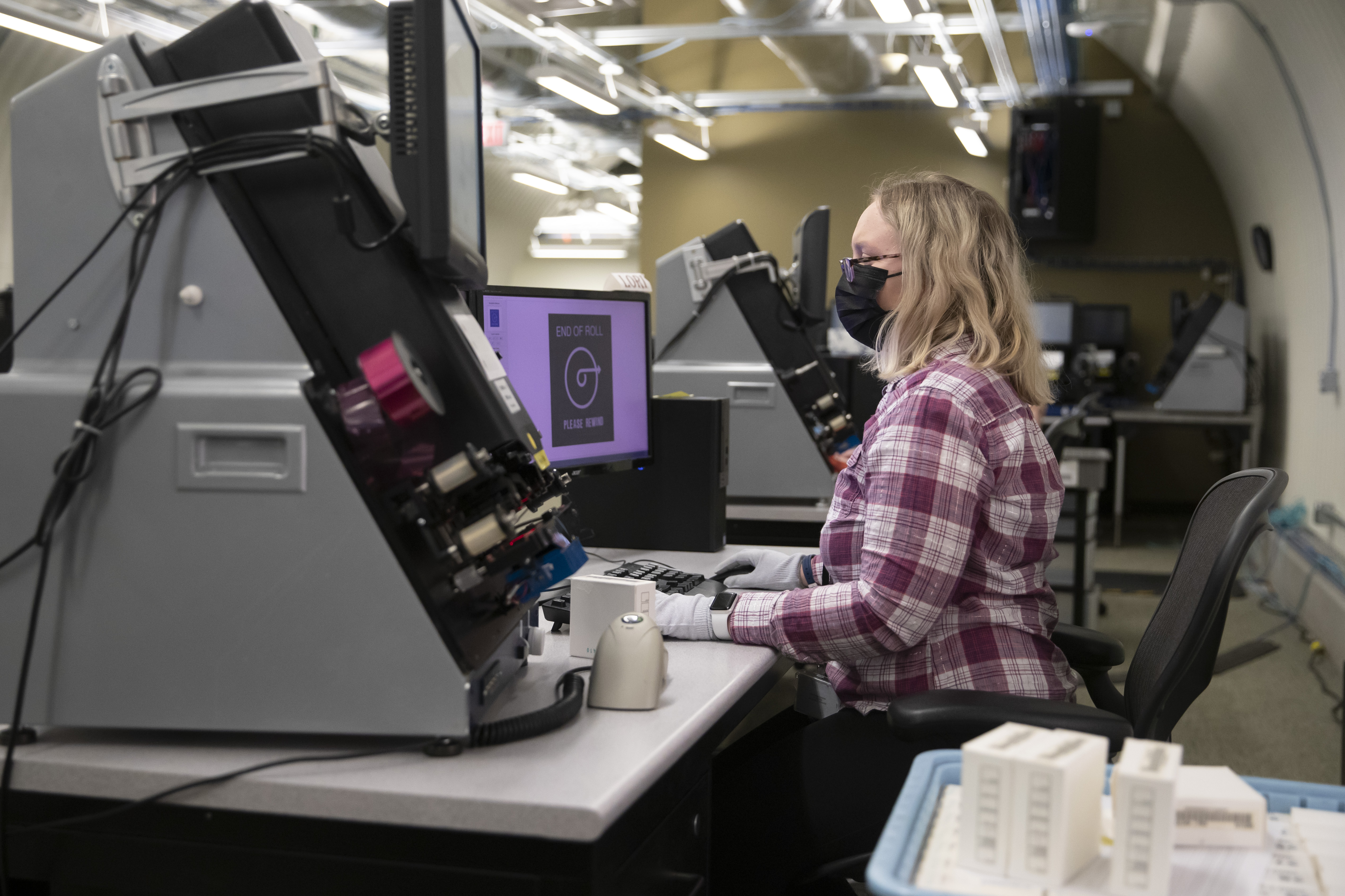 A woman uses technology to digitize family history records for The Church of Jesus Christ of Latter-day Saints.
